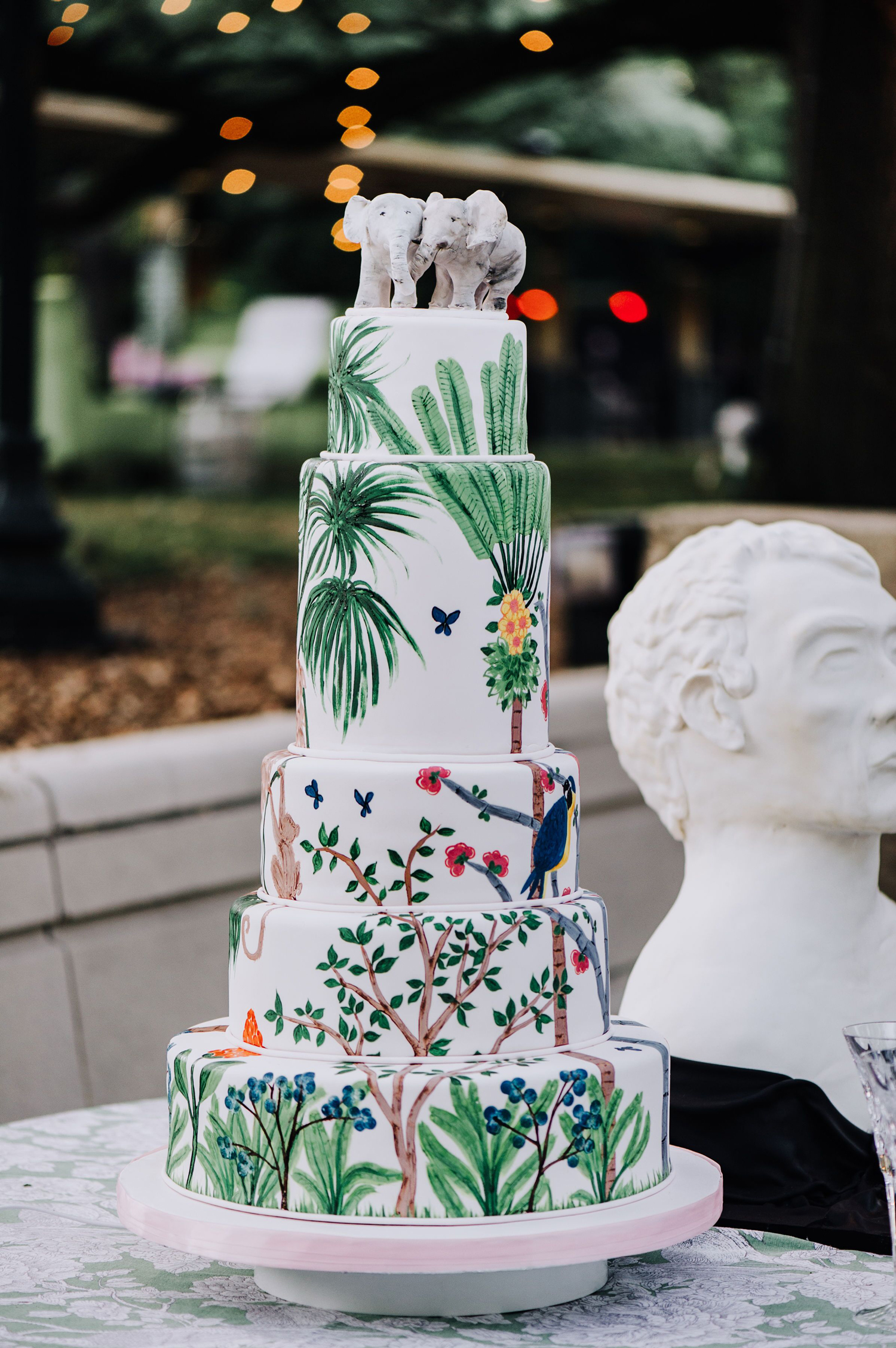 cathleen and winston wedding amazon theme painted cake topped with two elephants