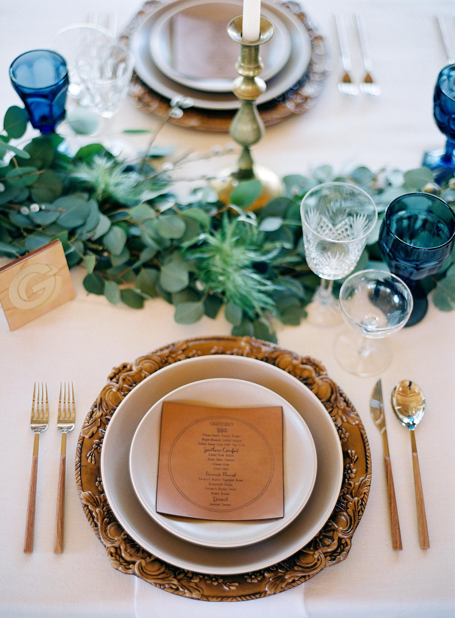leather wedding ideas menu on formal plate setting