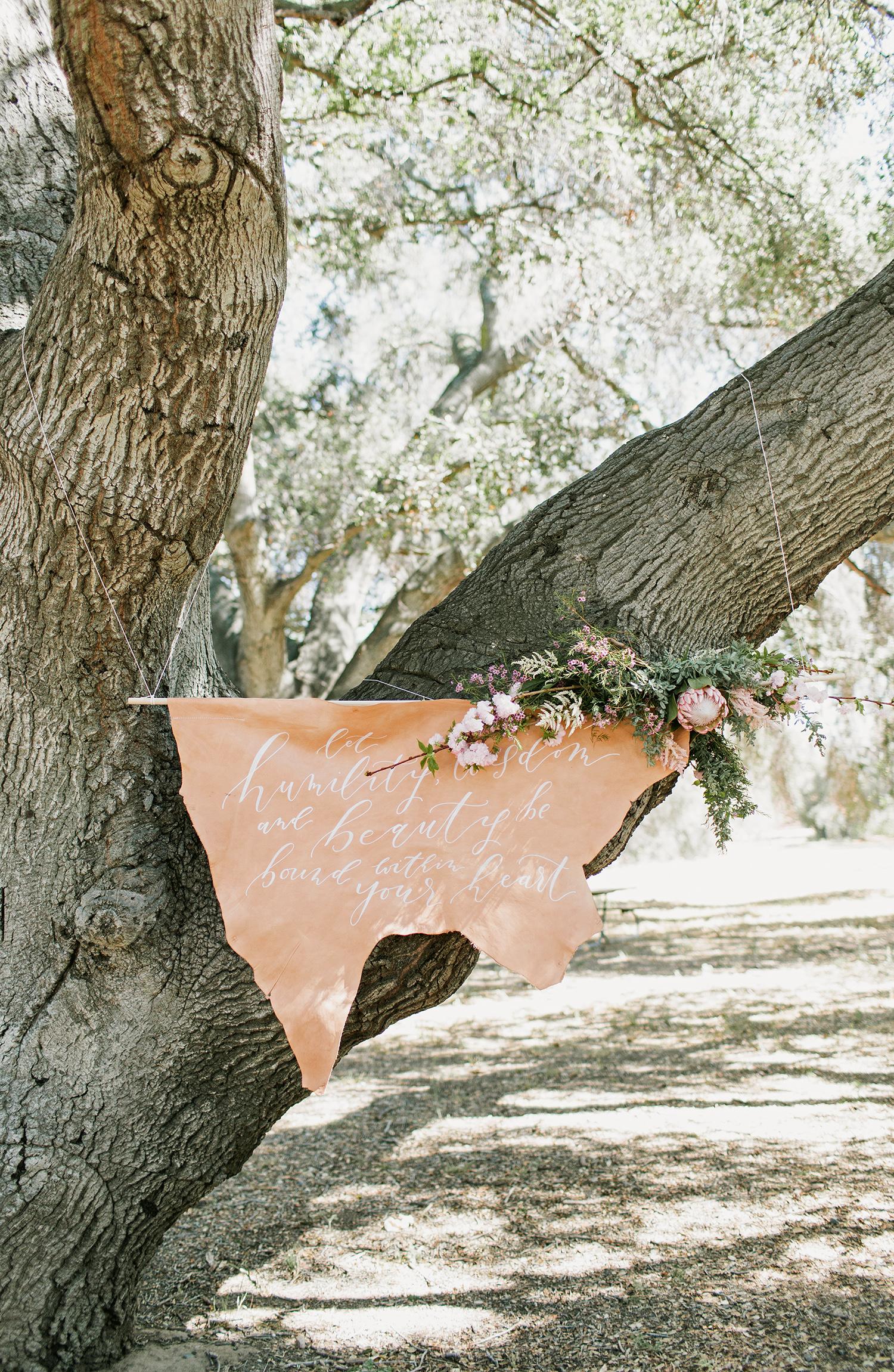 leather wedding ideas bohemian wedding sign in tree