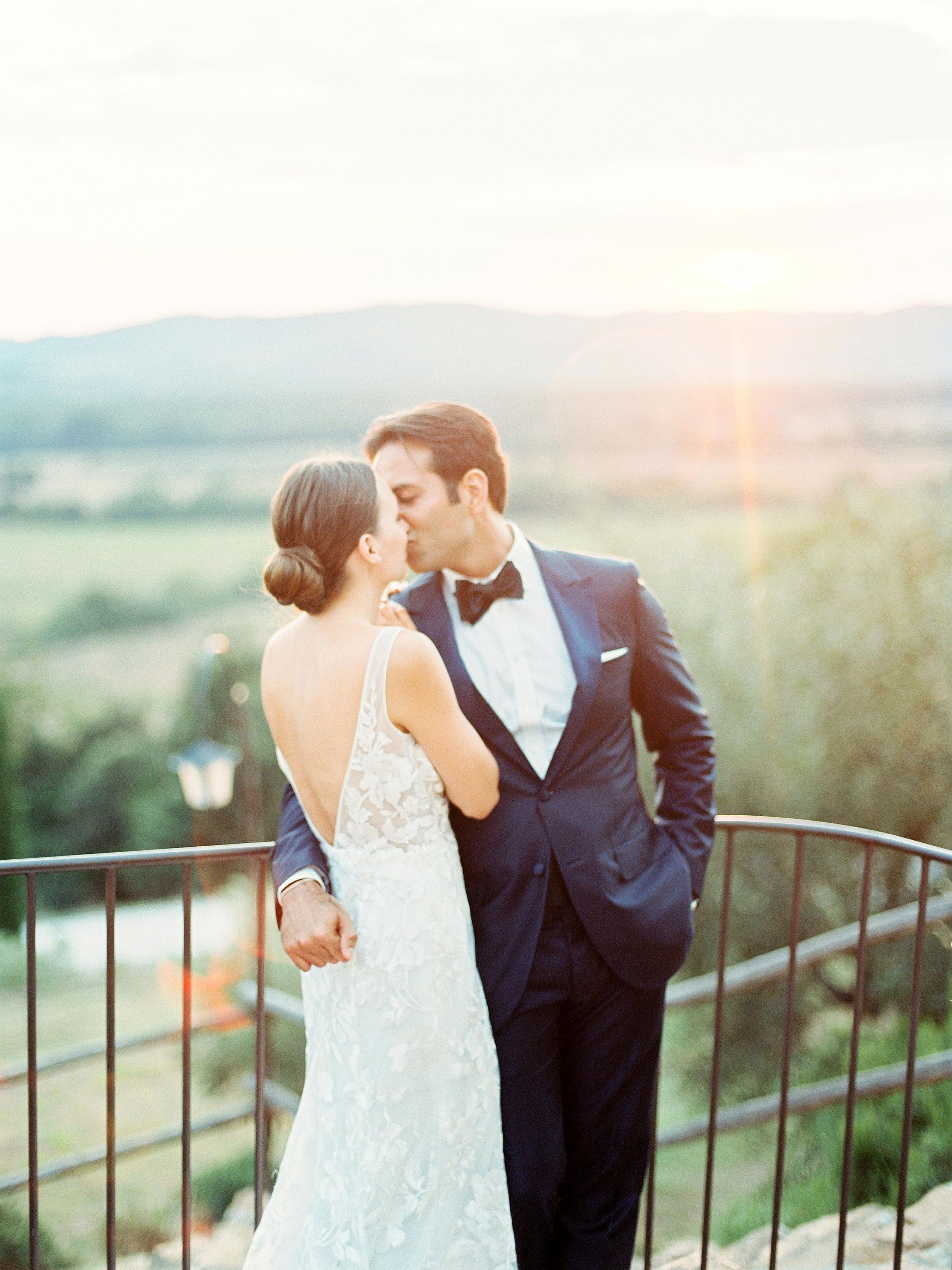 kseniya sadhir wedding couple kissing on balcony
