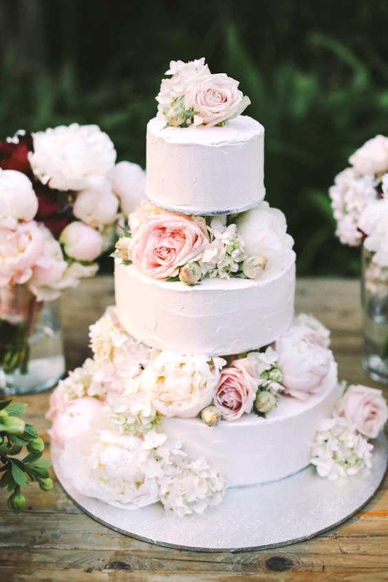cakes with floral tiers seasonal buds pink white roses