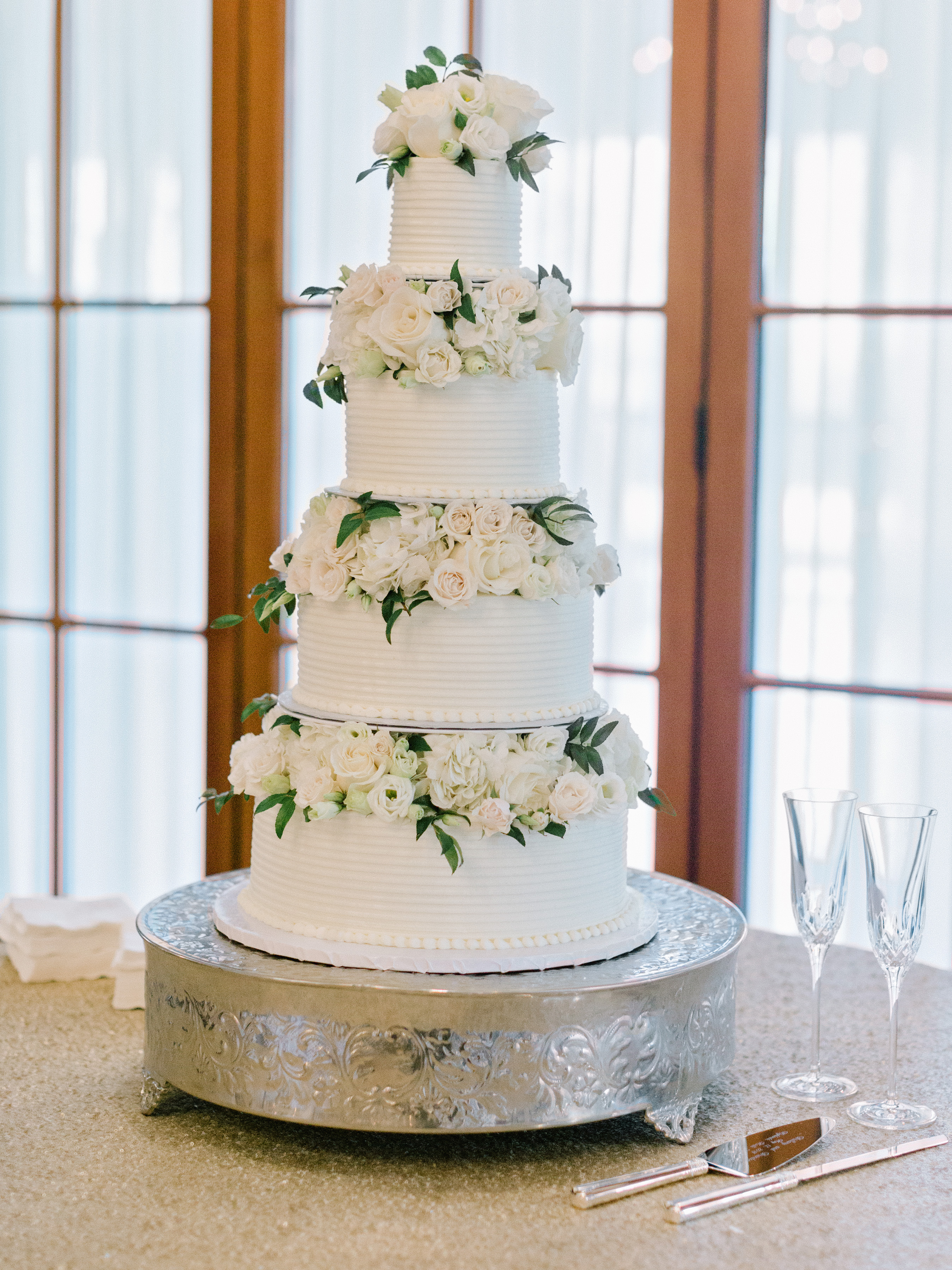 cakes with floral tiers bloom-filled horizontal icing ridges