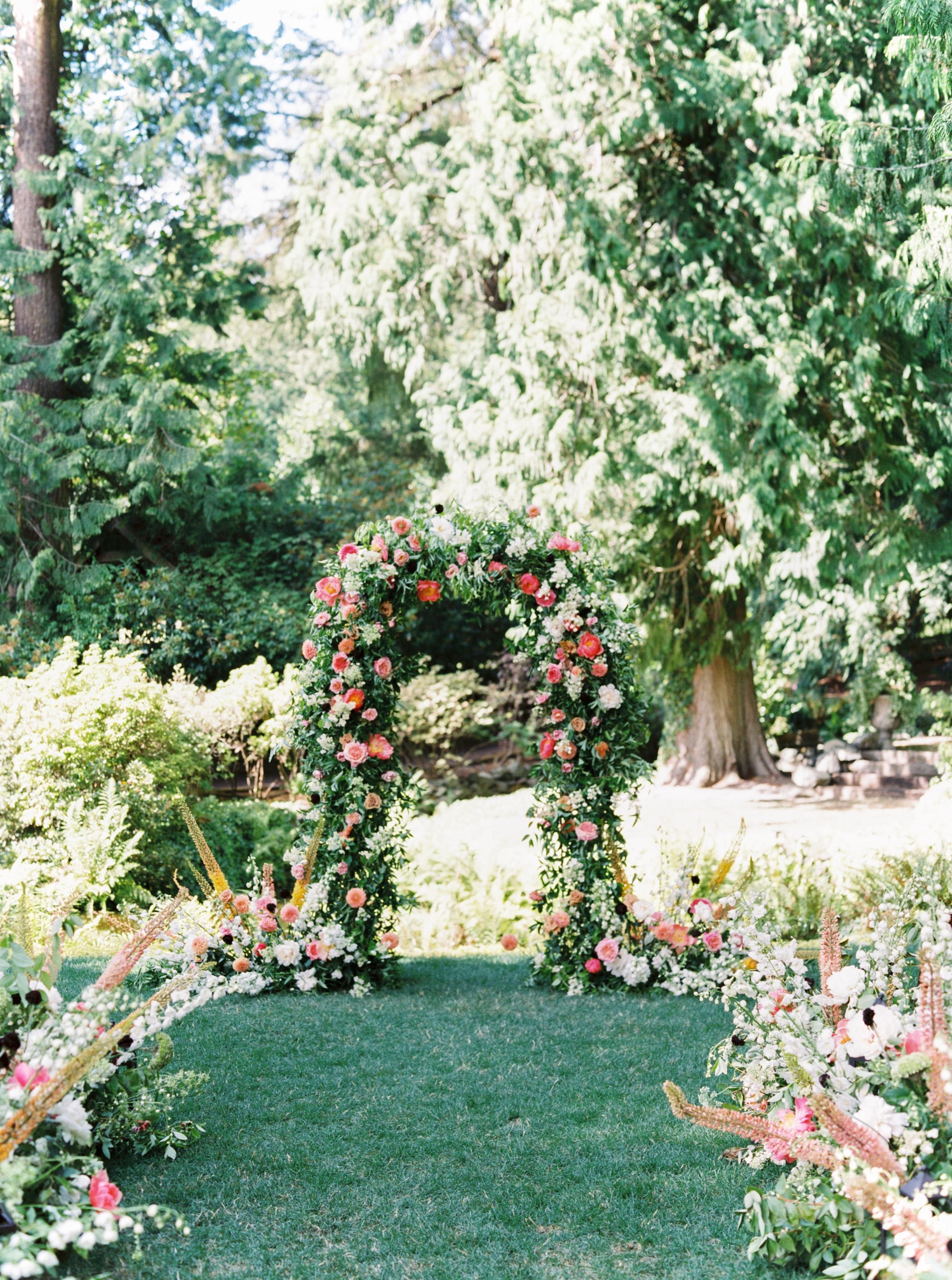paige matt wedding ceremony flowered arch