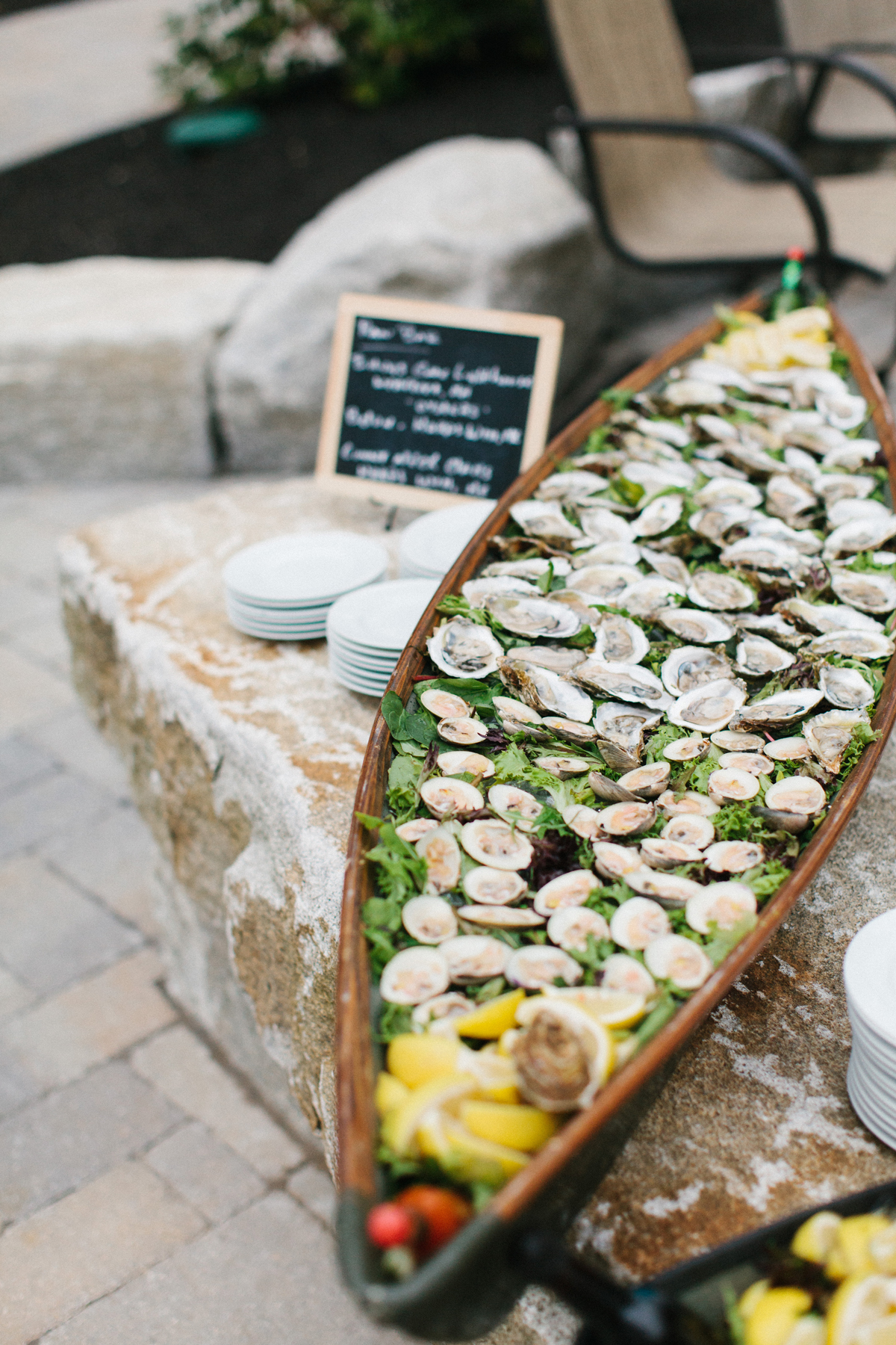 canoe shaped oversized serving tray filled with seafood