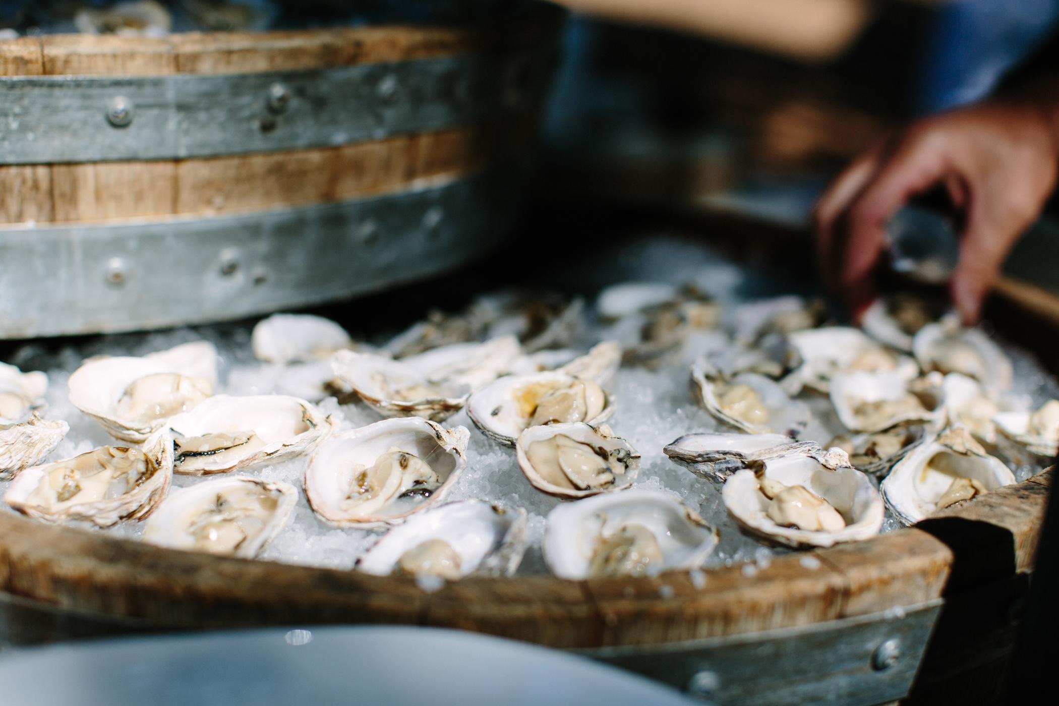 metal barrels filled with seafood
