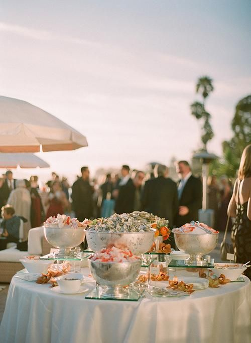round white linen covered table with seafood bar