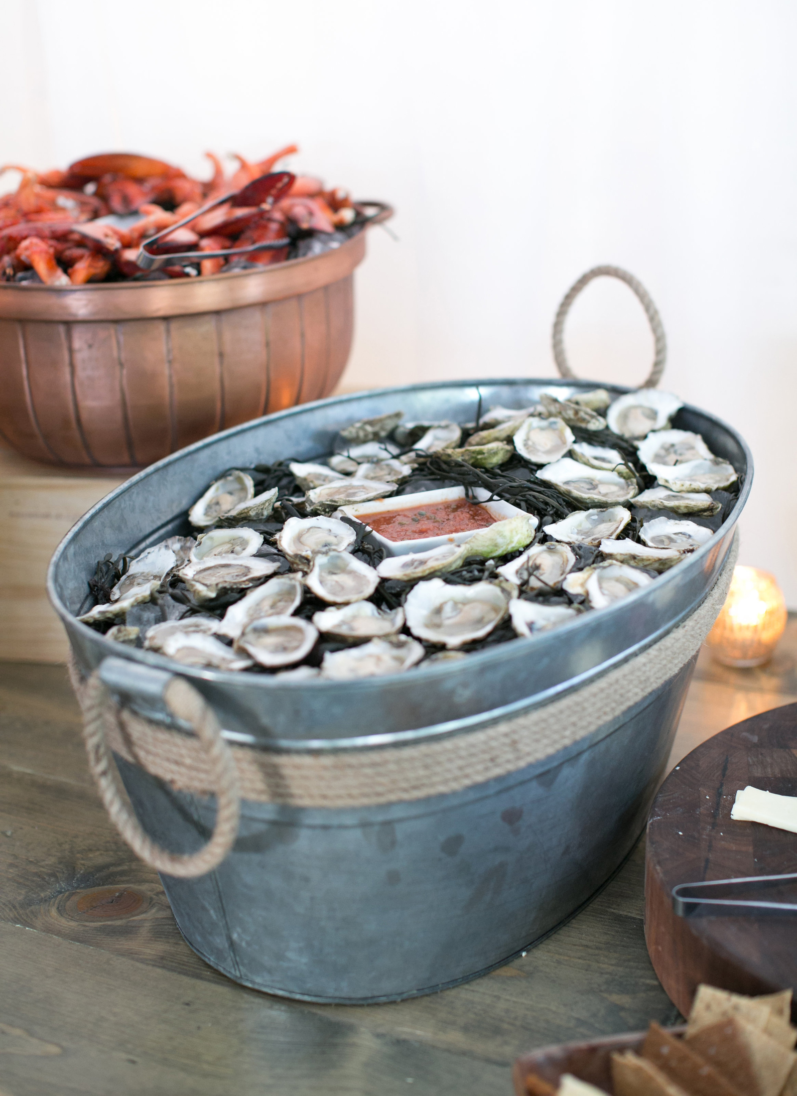 seafood filled metal barrel with rope decor