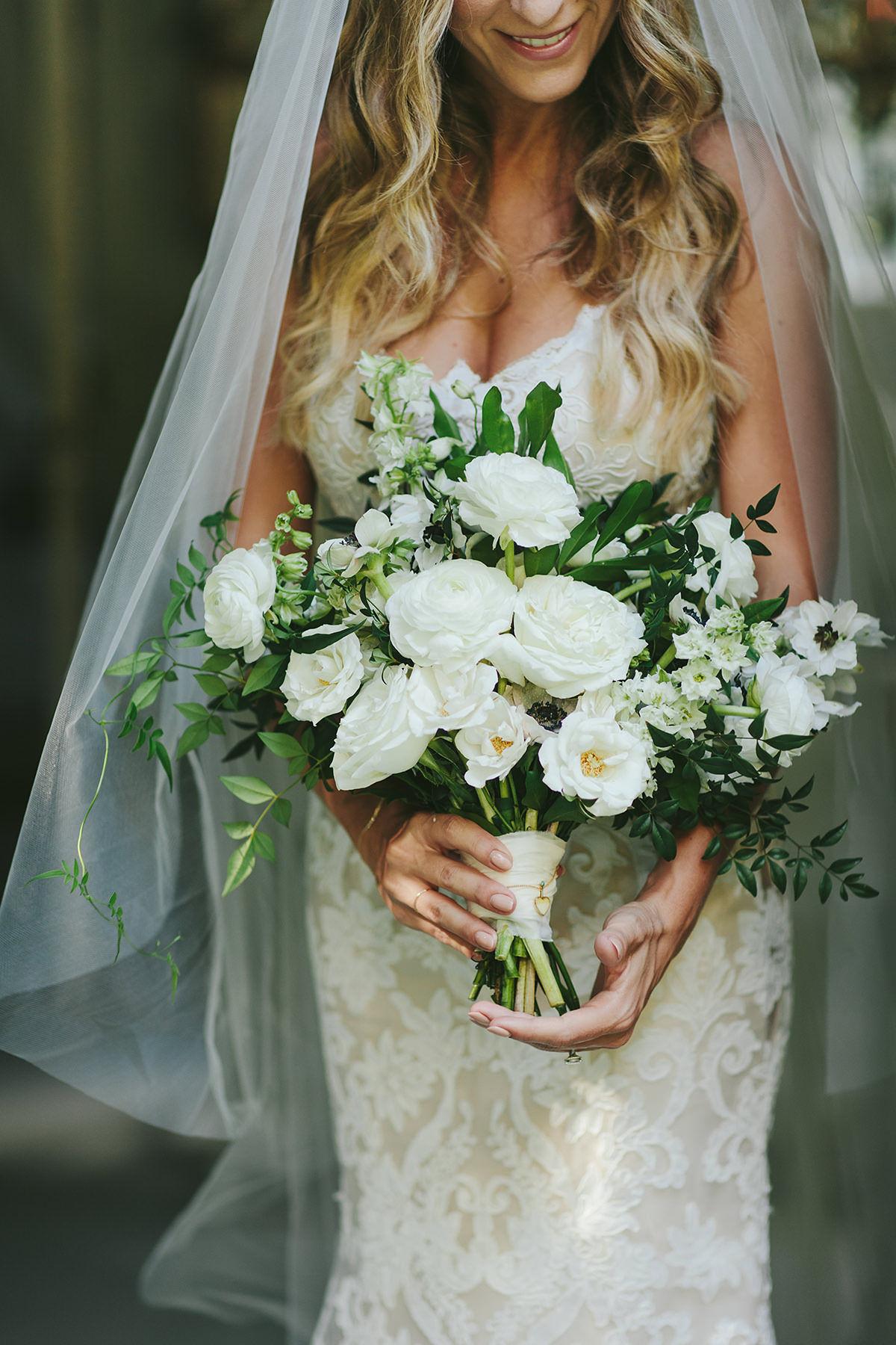 sarah daniel wedding bride holding bouquet