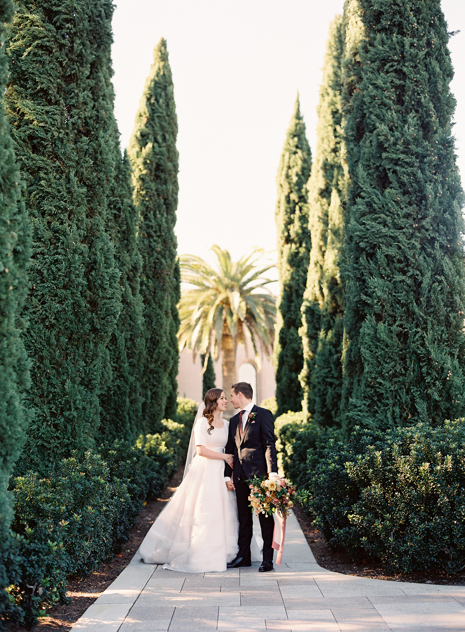 brooke dalton wedding couple between hedges