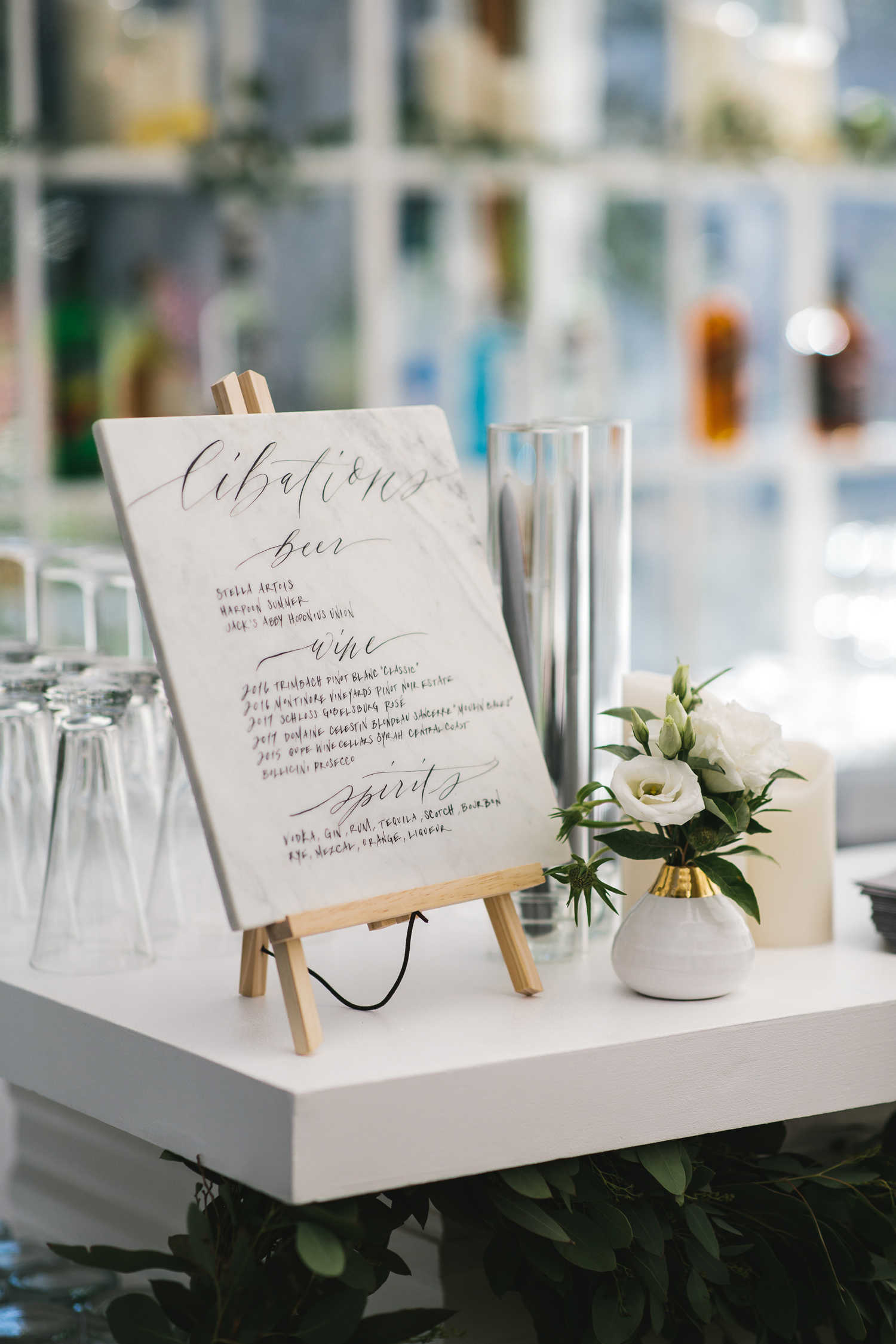 marble drink menu on white bar top