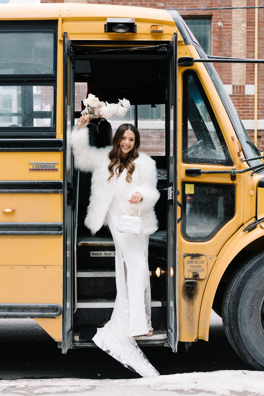 krista will wedding bride posing in school bus entrance