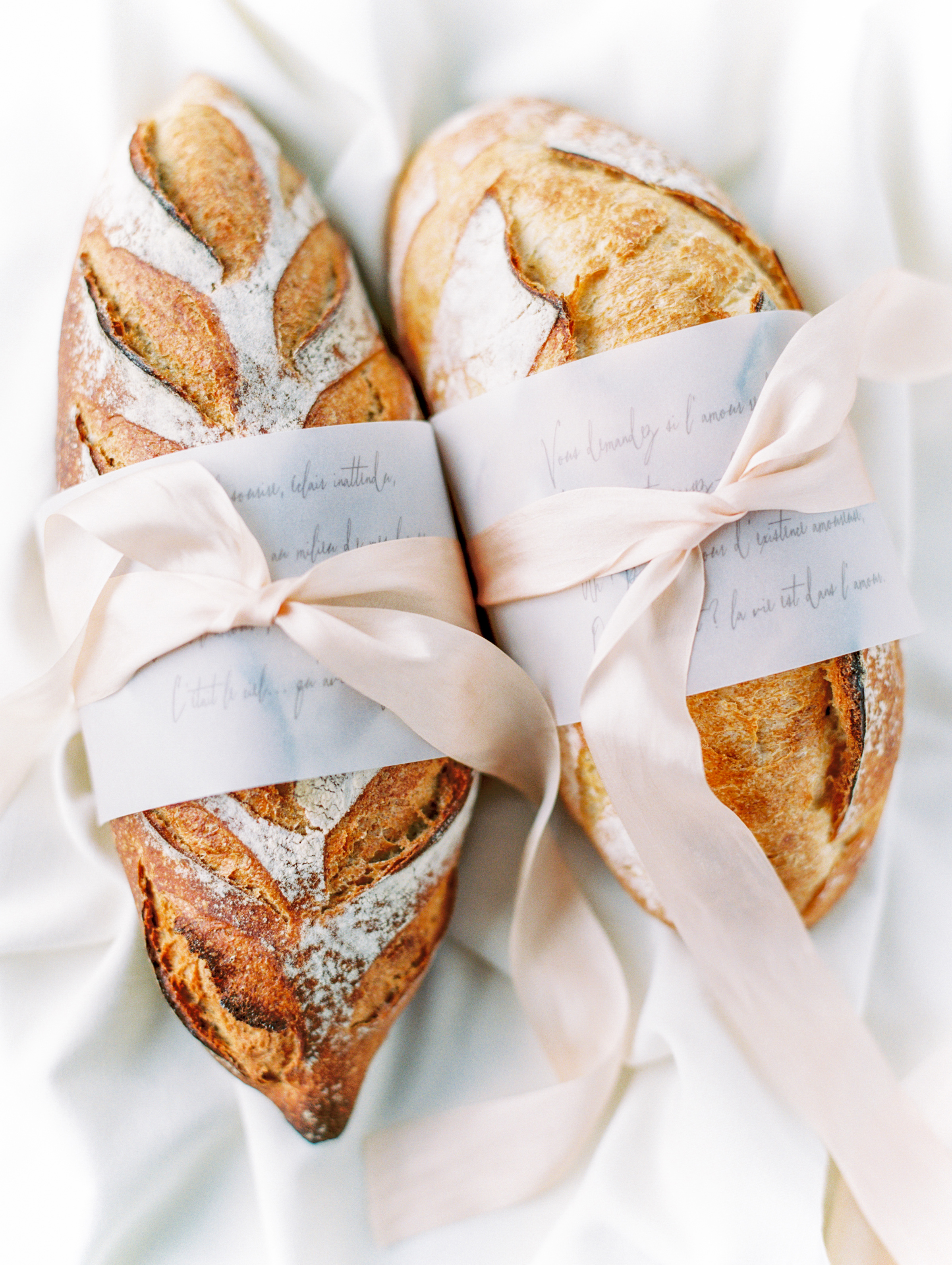 bread loaves in calligraphed sleeves