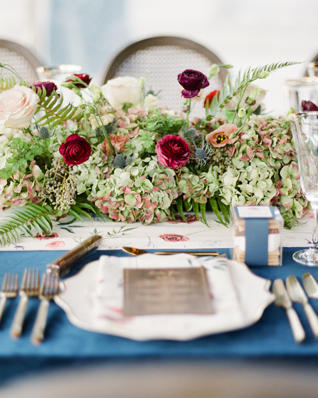 maidenhair ferns, plumosa, flat ferns, ranunculous, privet berry, antique hydrangea, and peonies centerpieces
