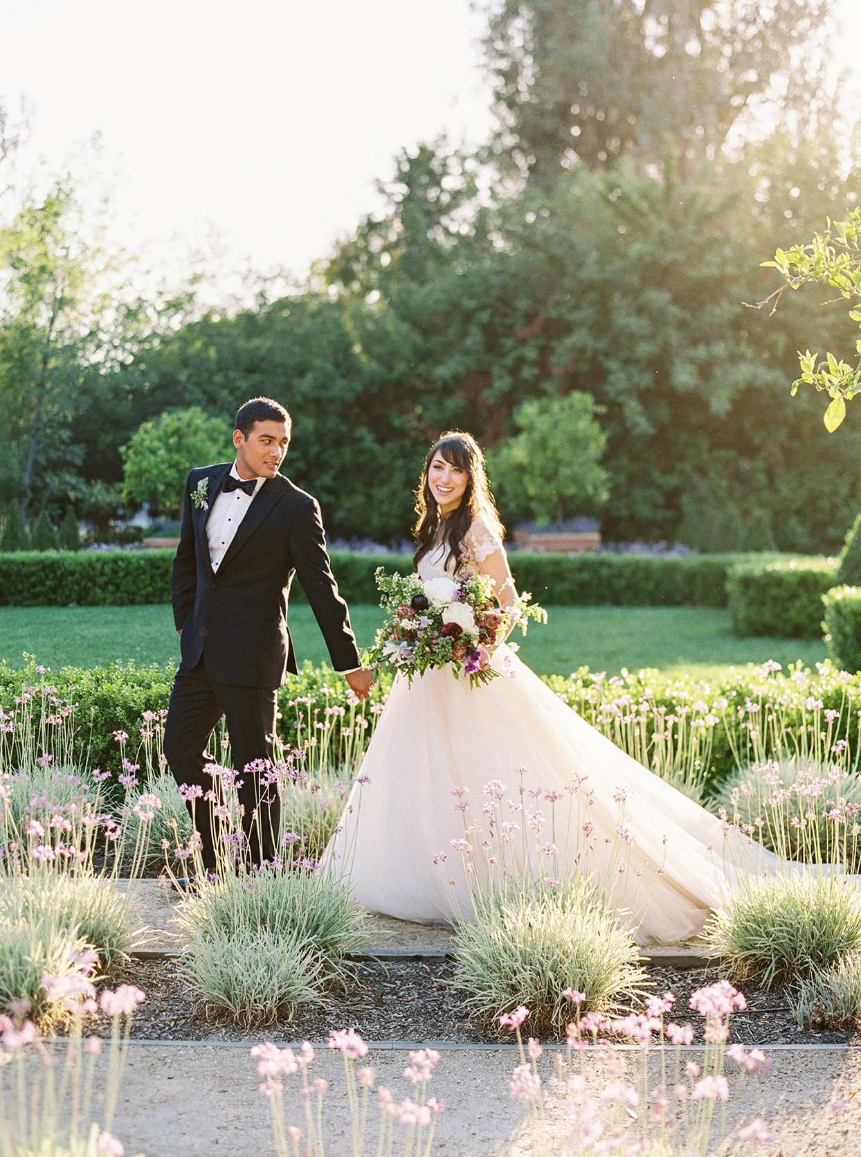 molly josh wedding couple walking in garden