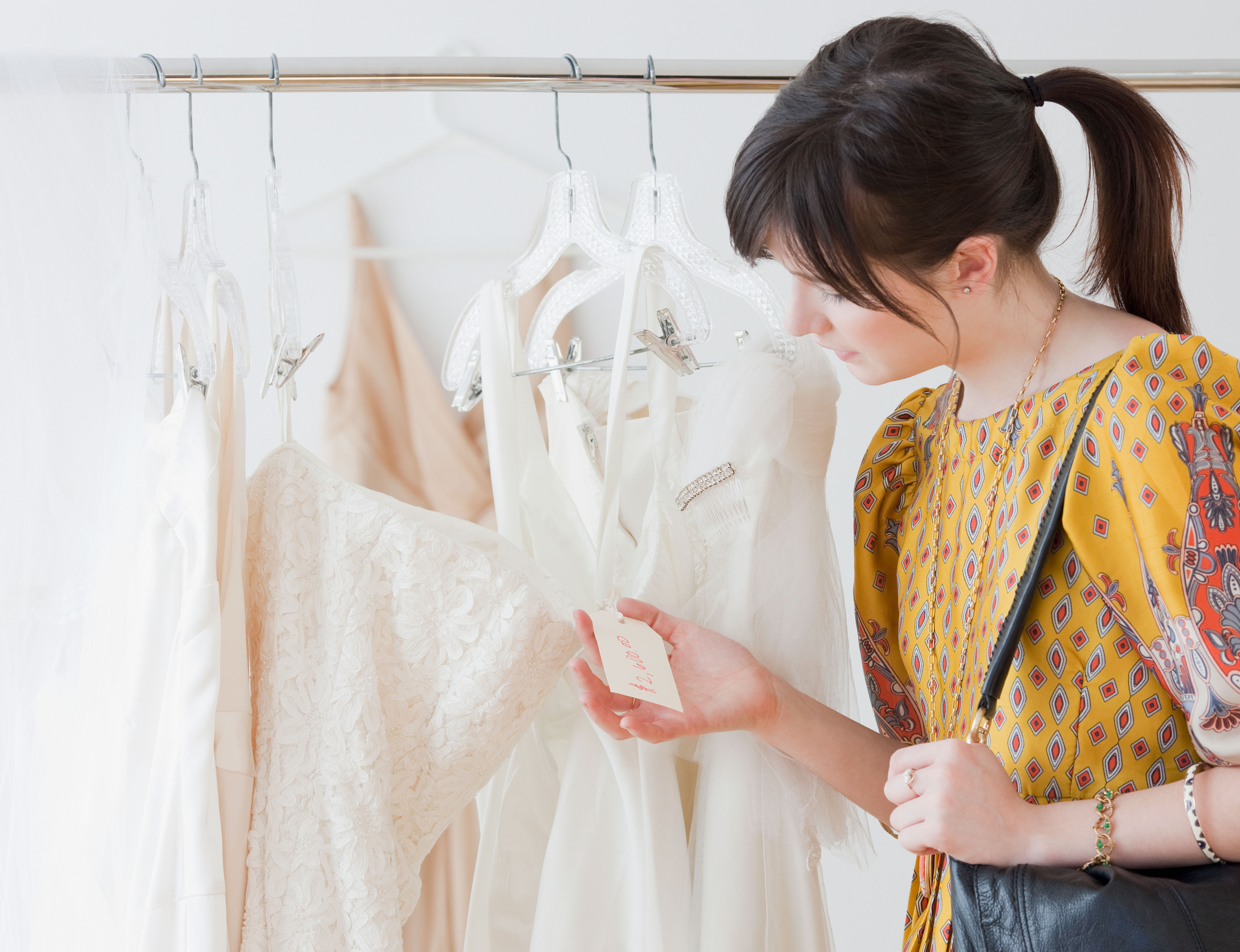 Is It Ever a Good Idea to Try on a Wedding Dress That You Know Is Too Expensive?