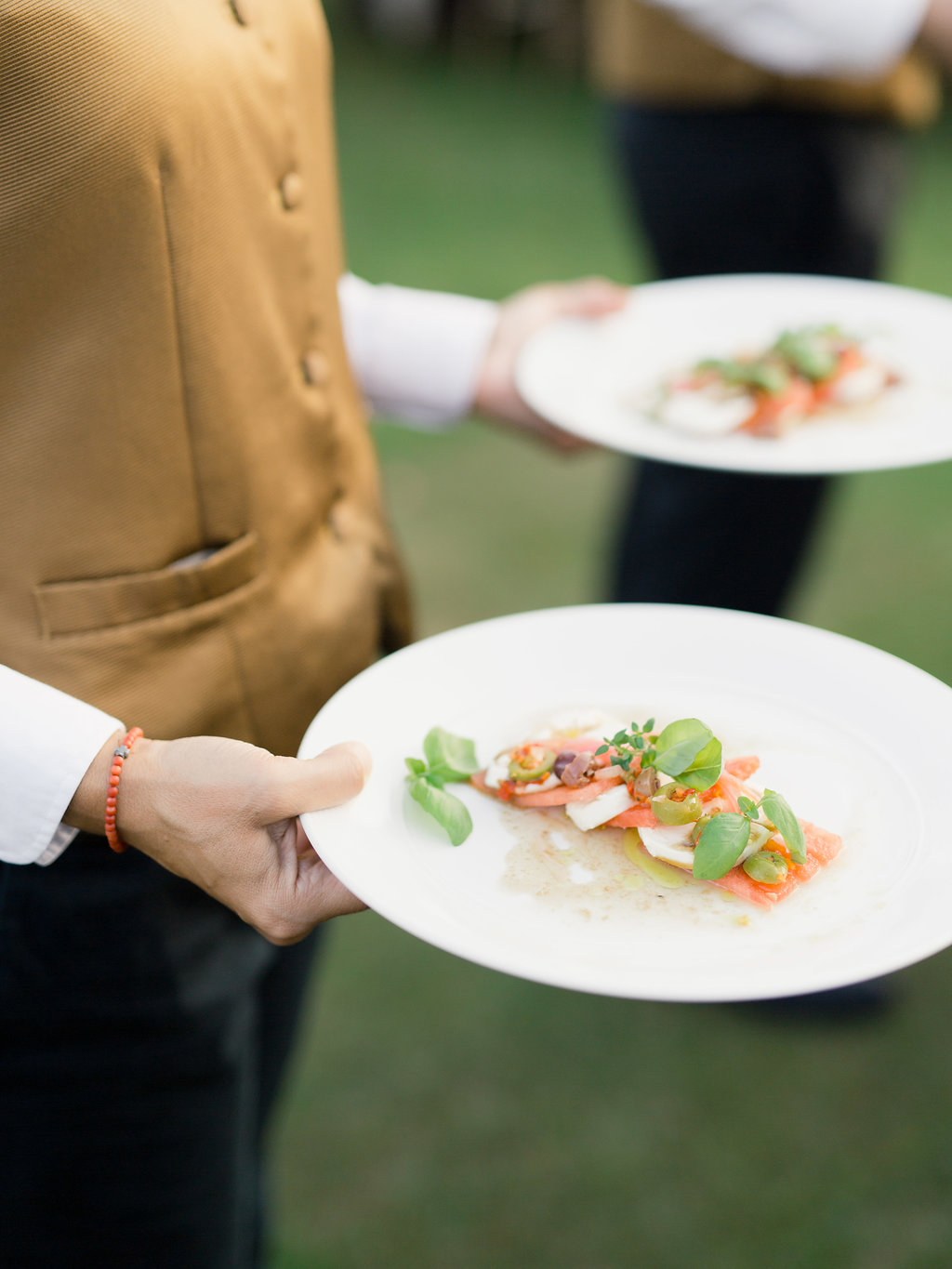 What Does a Caterer Typically Provide as Part of a Wedding Package?