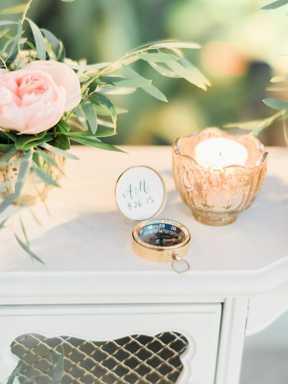 compass wedding ideas favors on white table