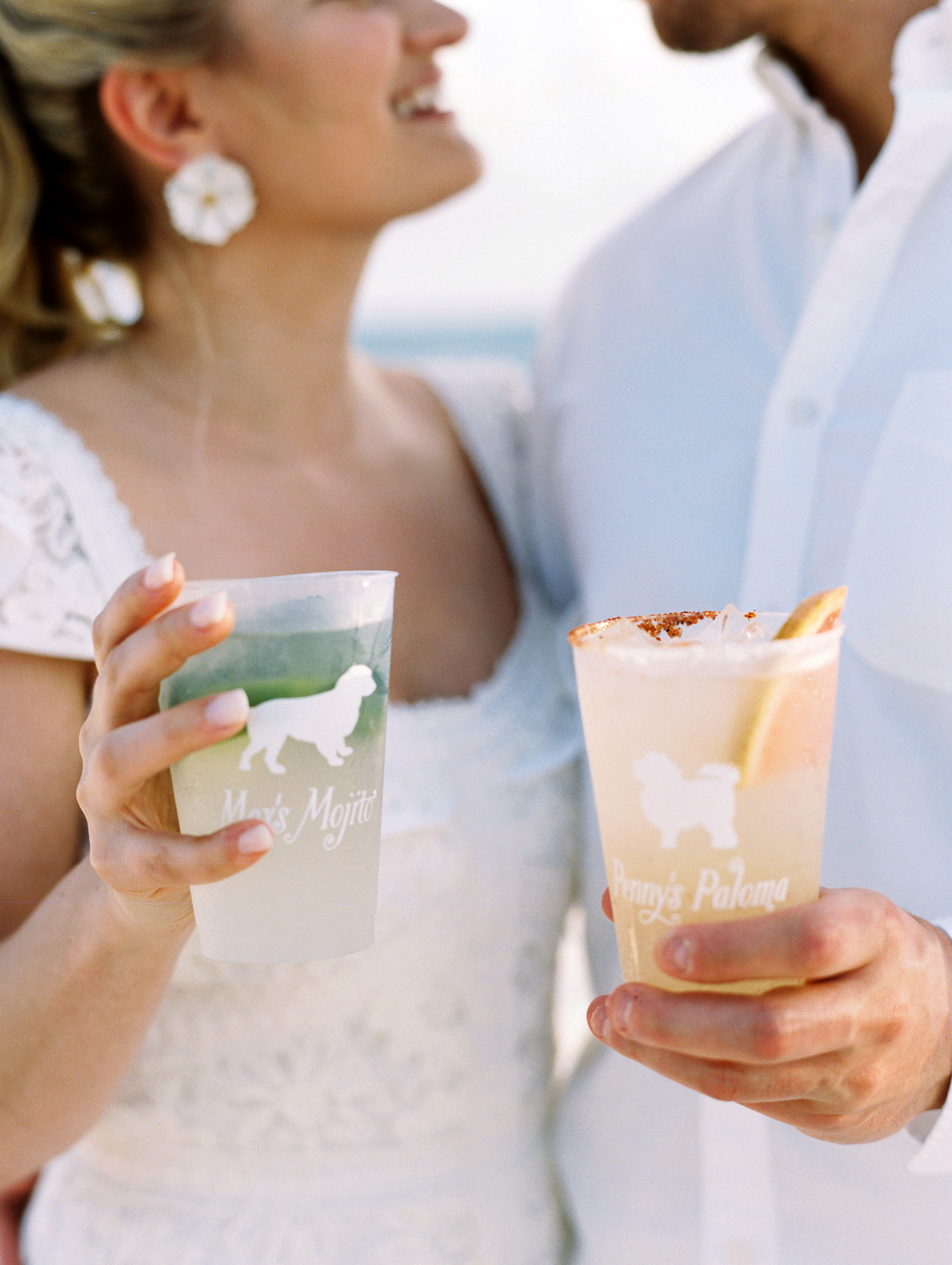 bride and groom holding palomas and mojitos signature cocktails