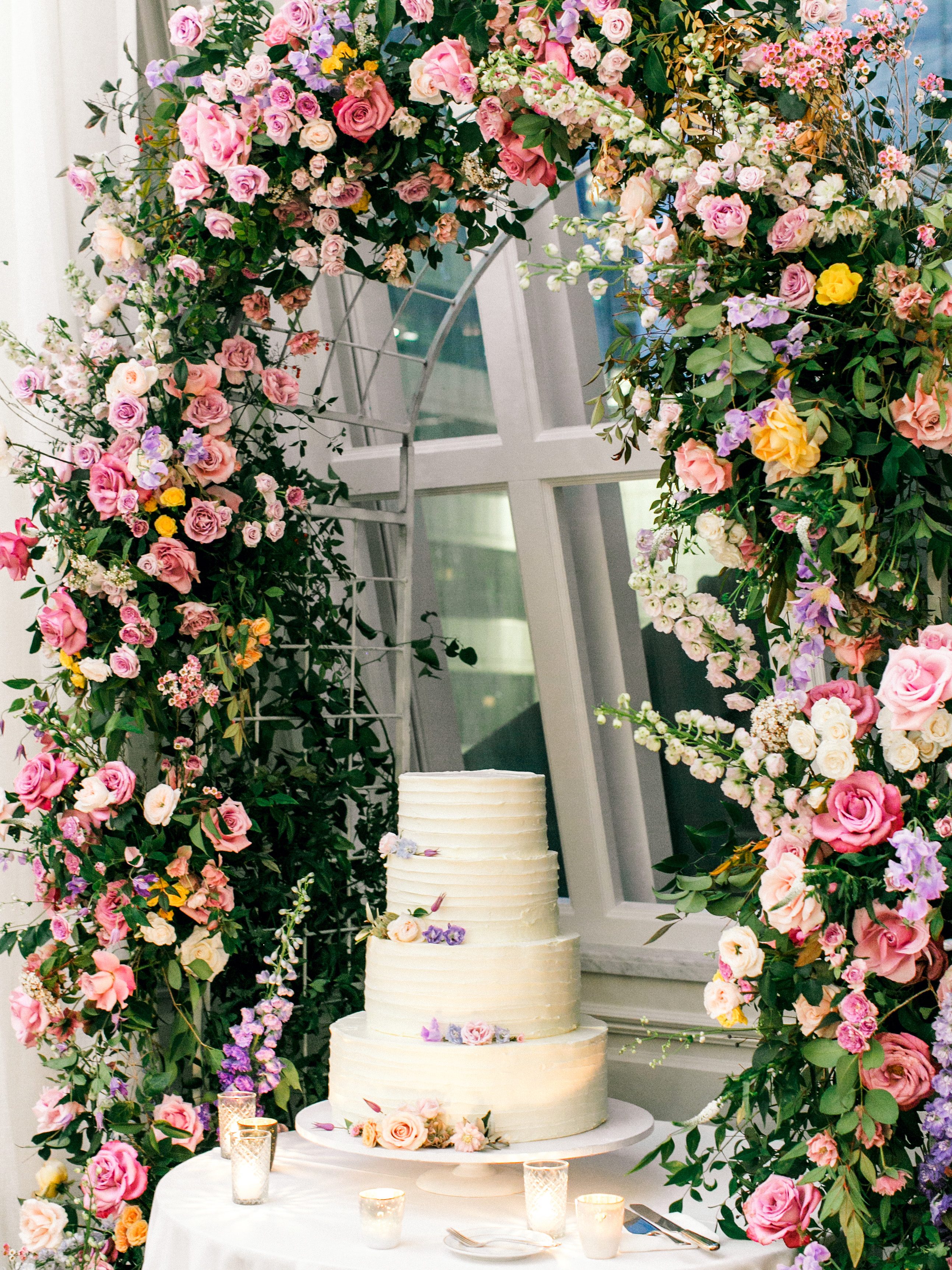stephanie joe wedding cake and floral arch