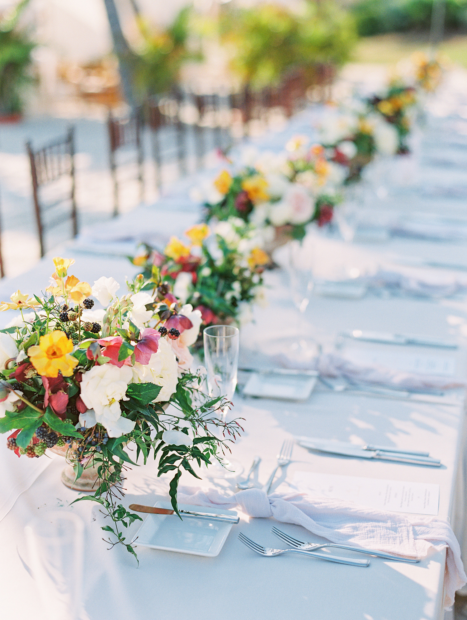 beth john wedding long table floral bouquets