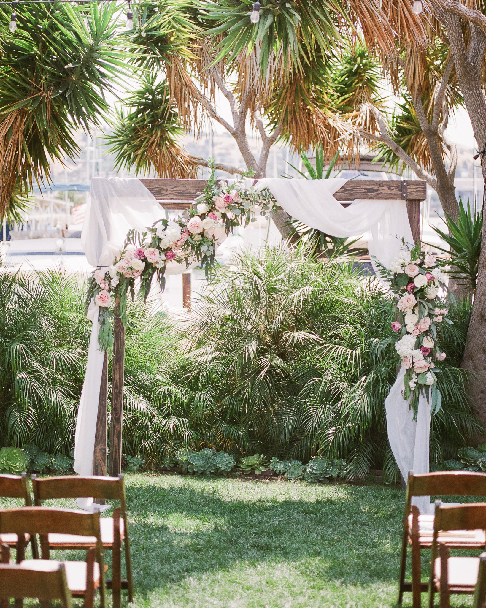outdoor wedding ceremony custom wooden frame arch