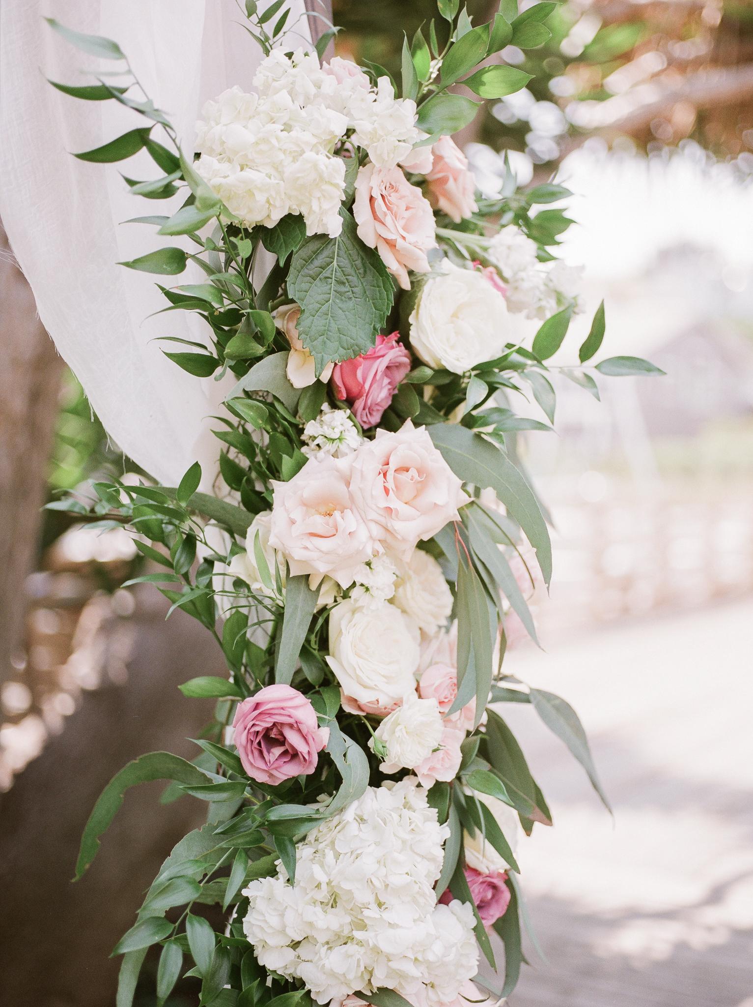 pink white floral arrangement foliage accents
