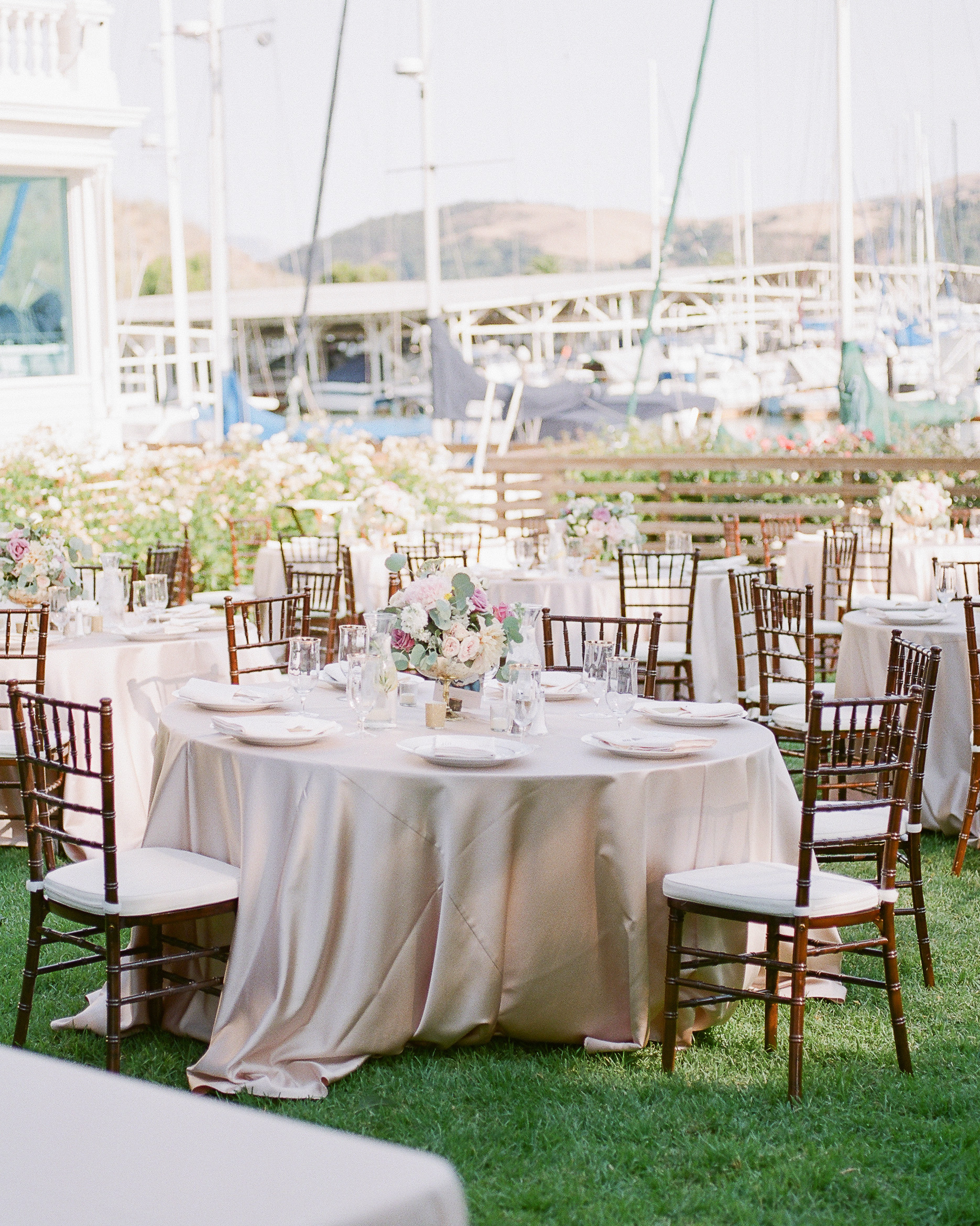 outdoor wedding reception round tables marina view