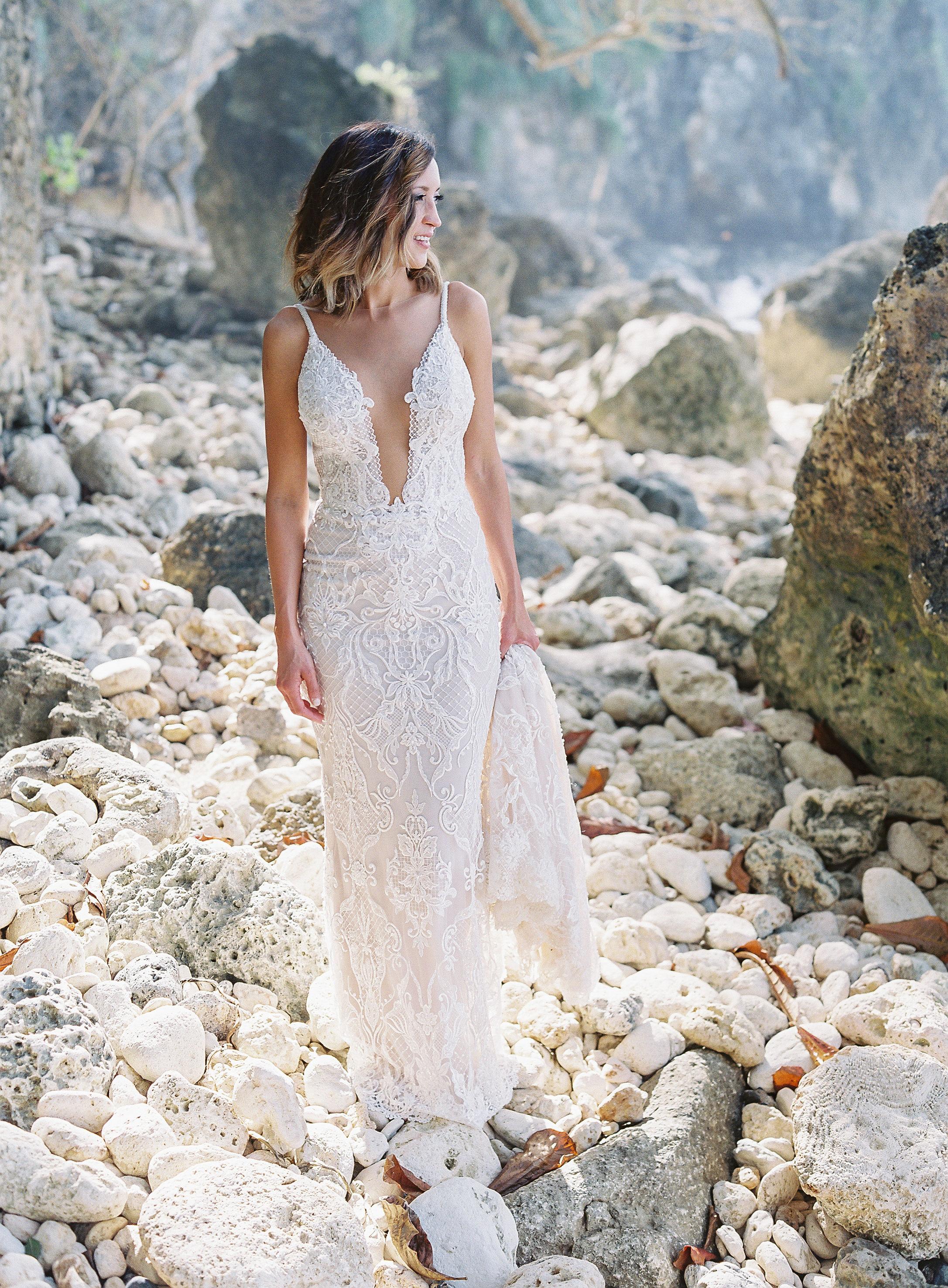 jessica ryan wedding bride standing on rocks