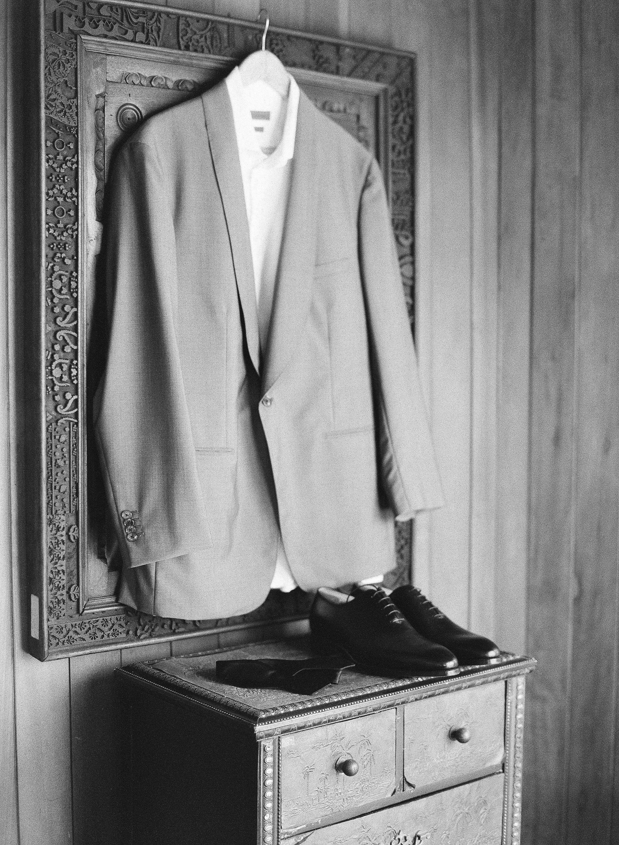 jessica ryan wedding groom's suit hanging