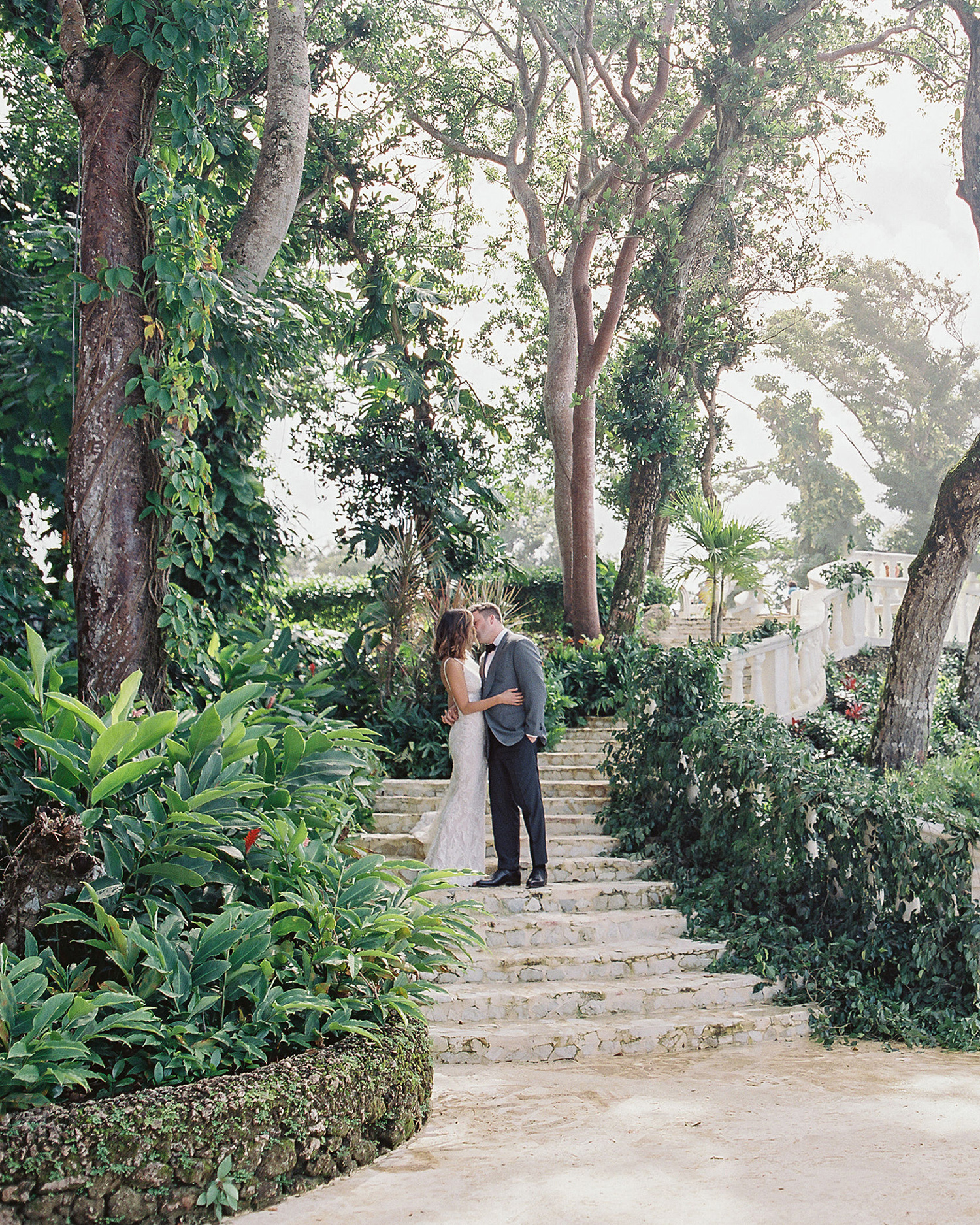 jessica ryan wedding couple kissing on stairway in lush garden