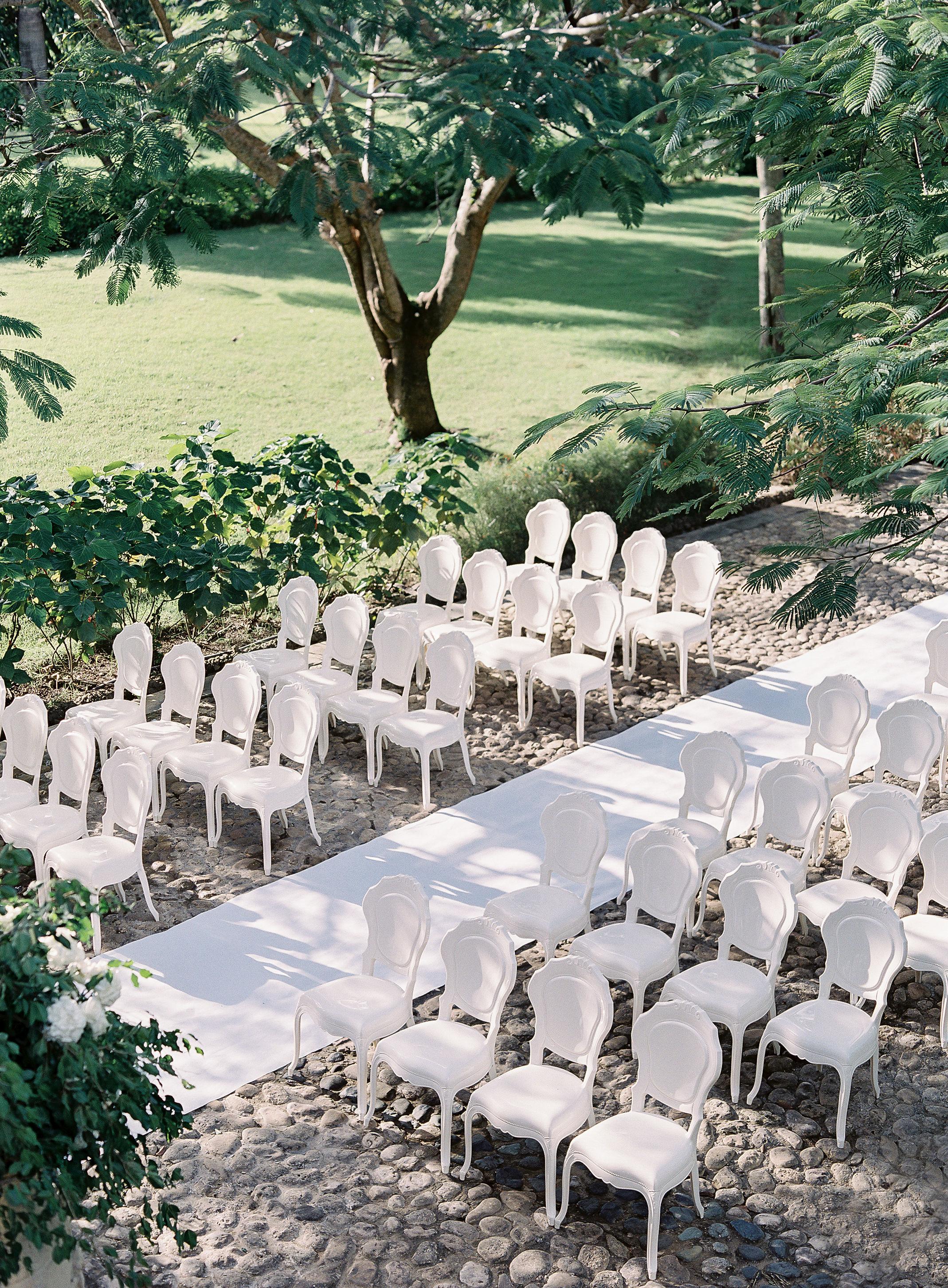 jessica ryan wedding ceremony white chairs and runner