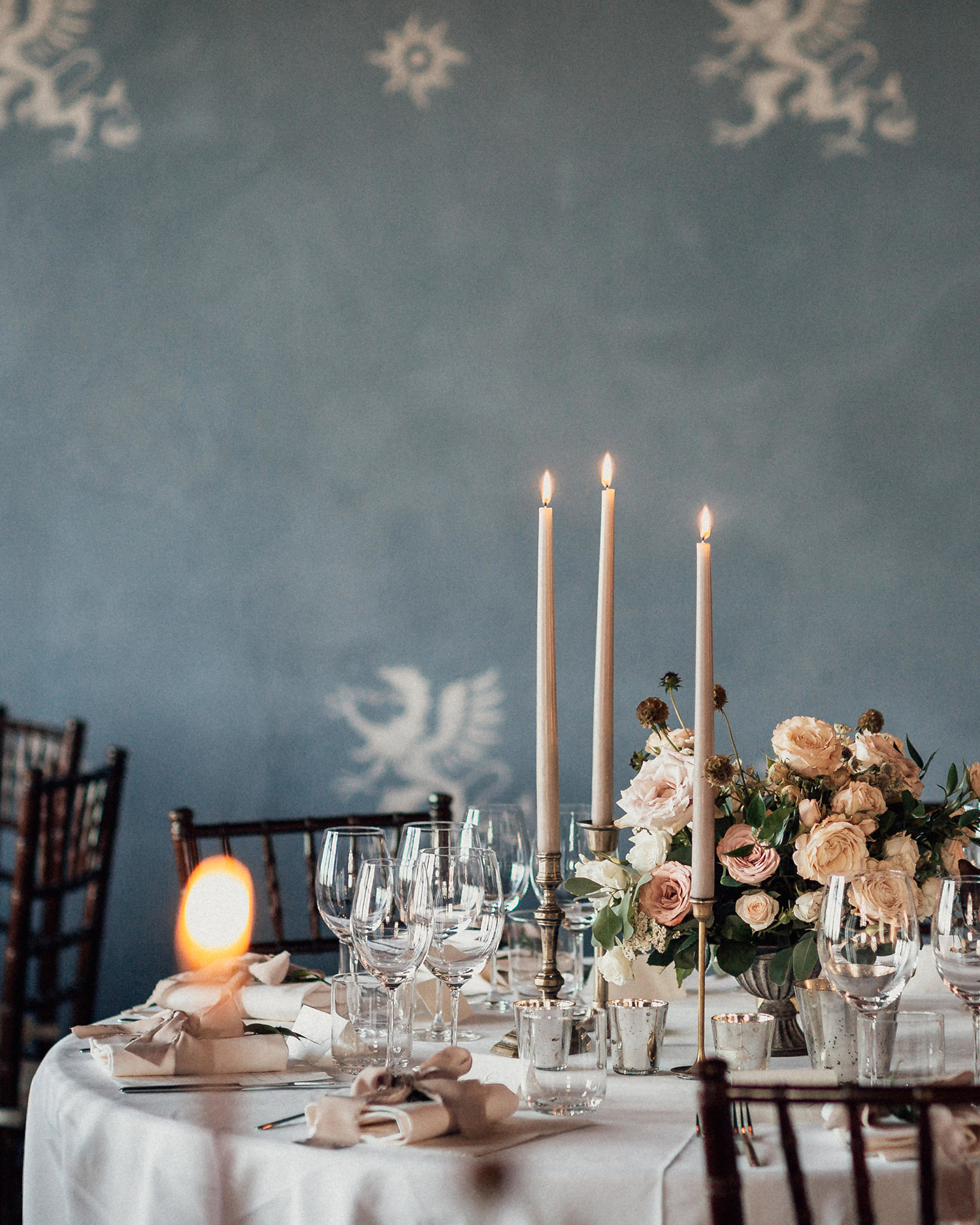 natalie paul wedding ornately decorated table against slate blue wall