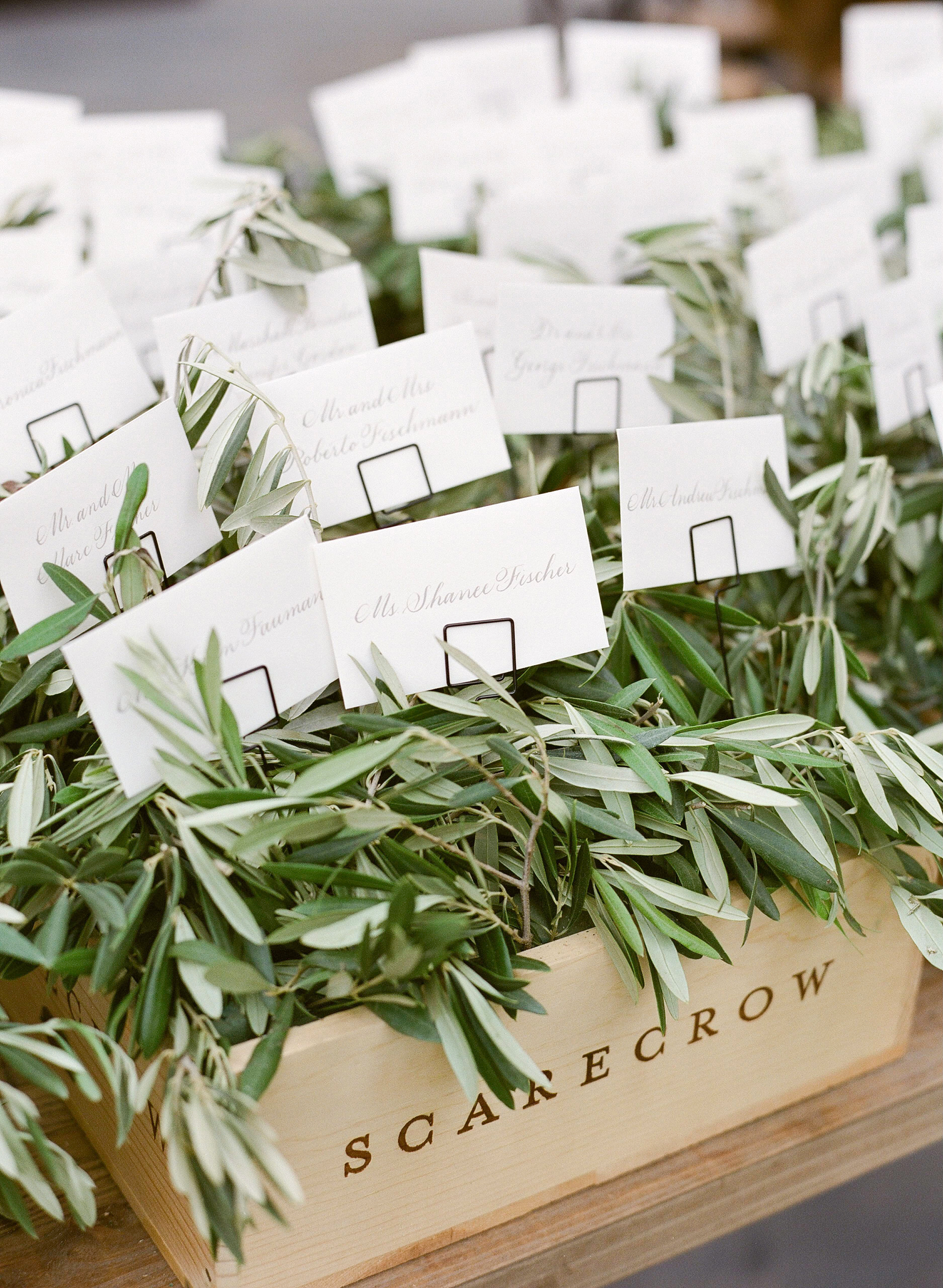 wooden boxes escort cards greenery
