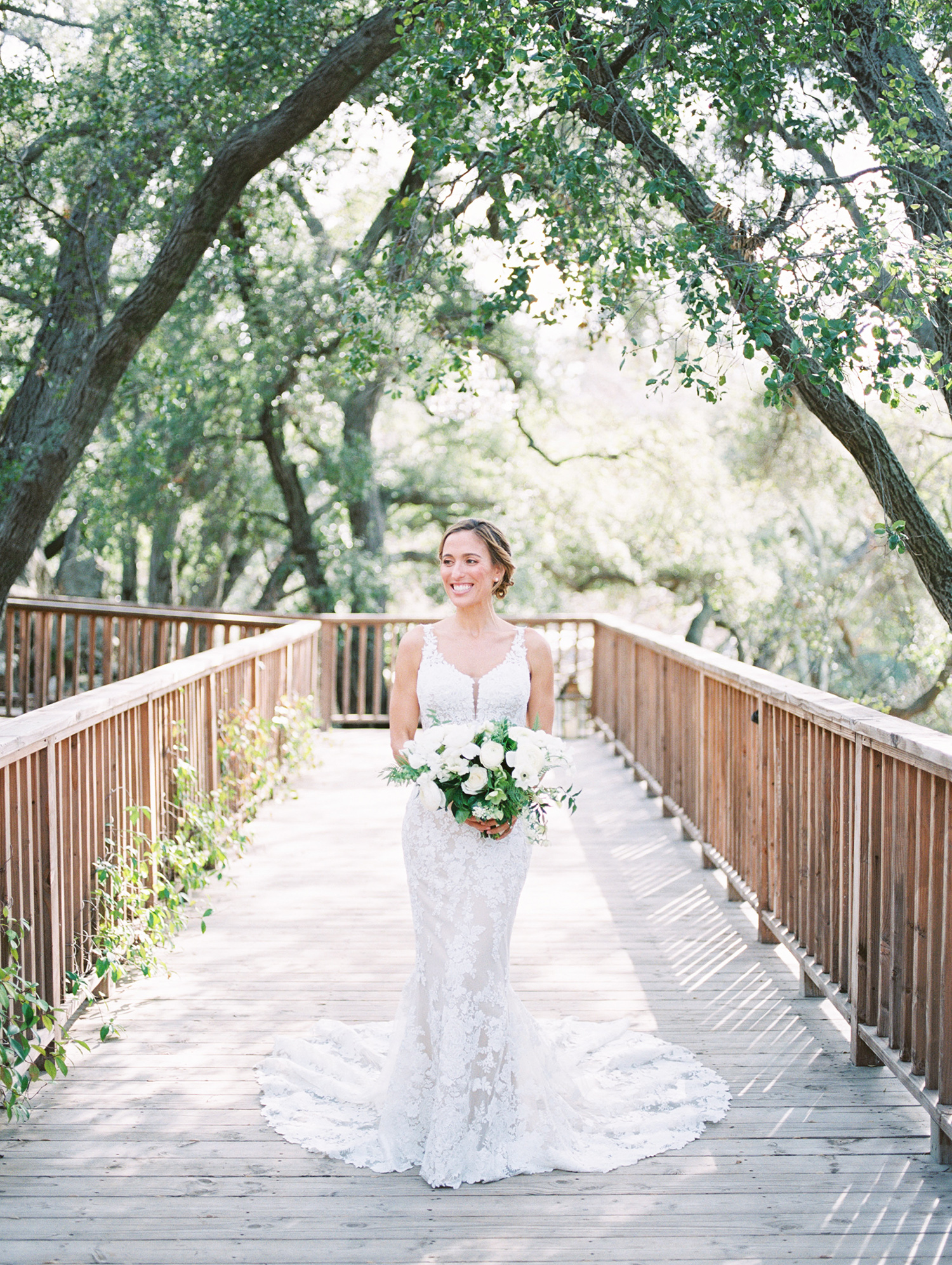 lauren aaron wedding bride on bridge