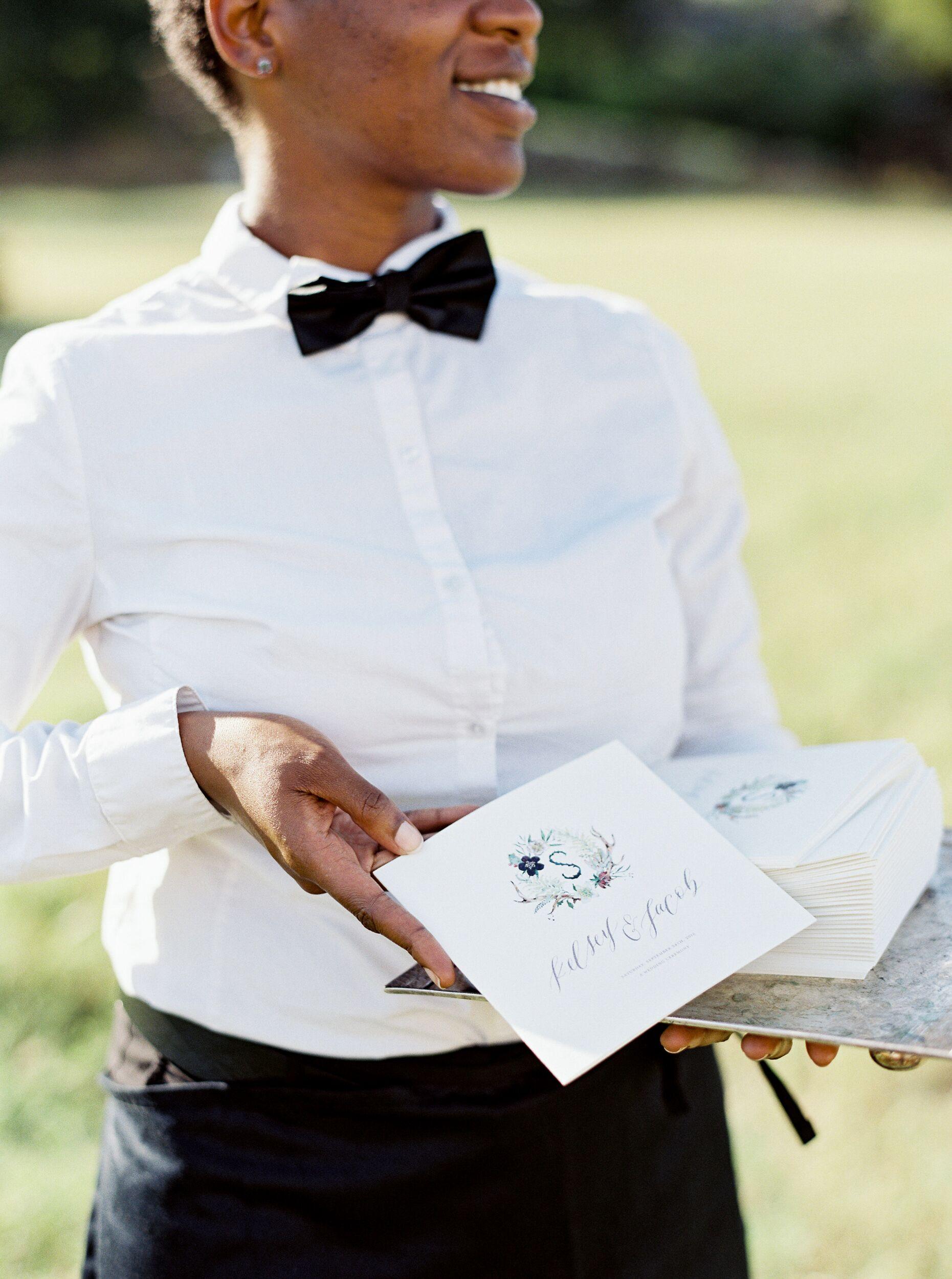 kelsey jacob wedding woman holding ceremony programs