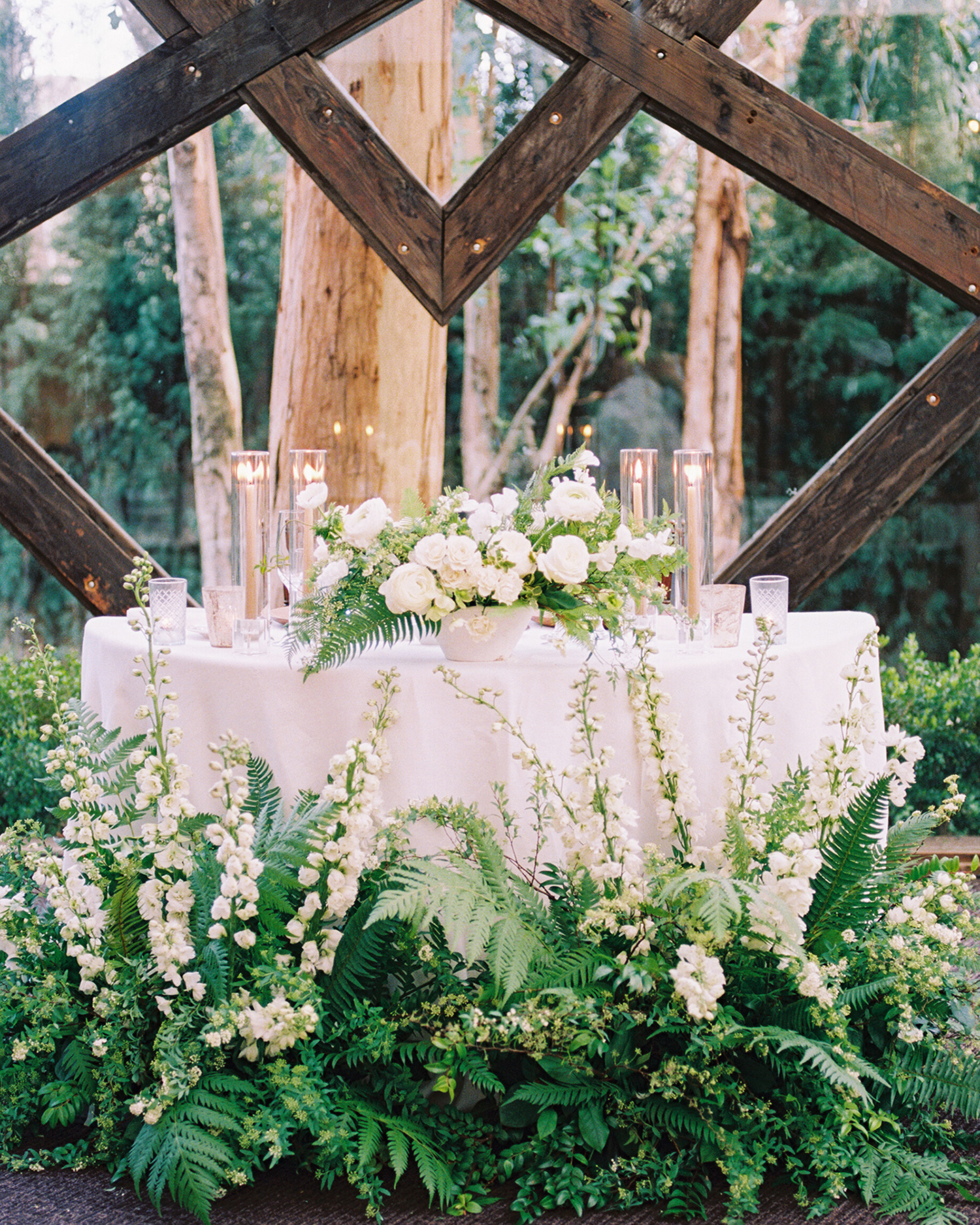 lauren aaron wedding head table surrounded by plants