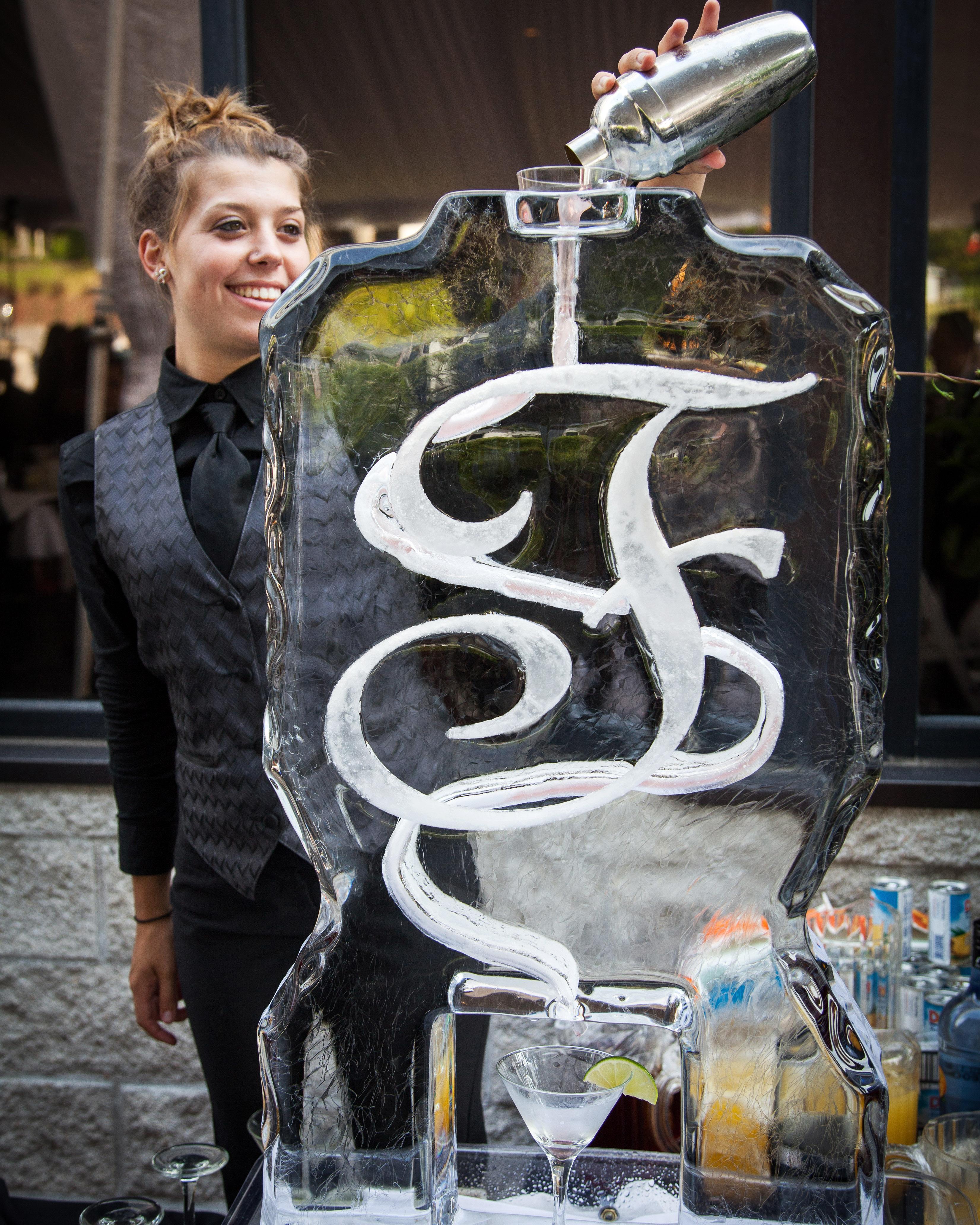 wedding ice sculpture monogrammed drink serving station
