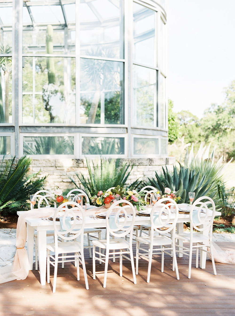 the greenhouse at driftwood glass house outdoor table setting
