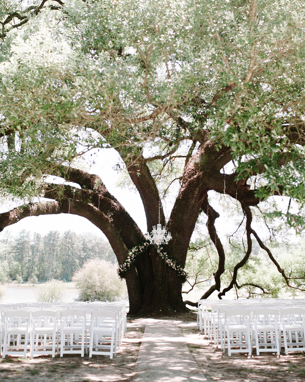 single chandelier wedding ceremony outdoor decor