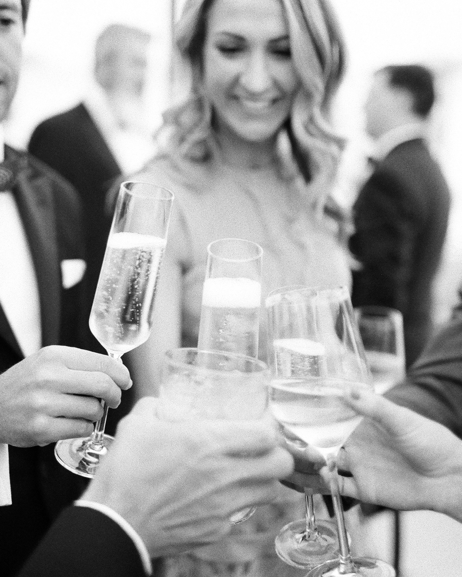 sloan scott wedding guests cheers champagne
