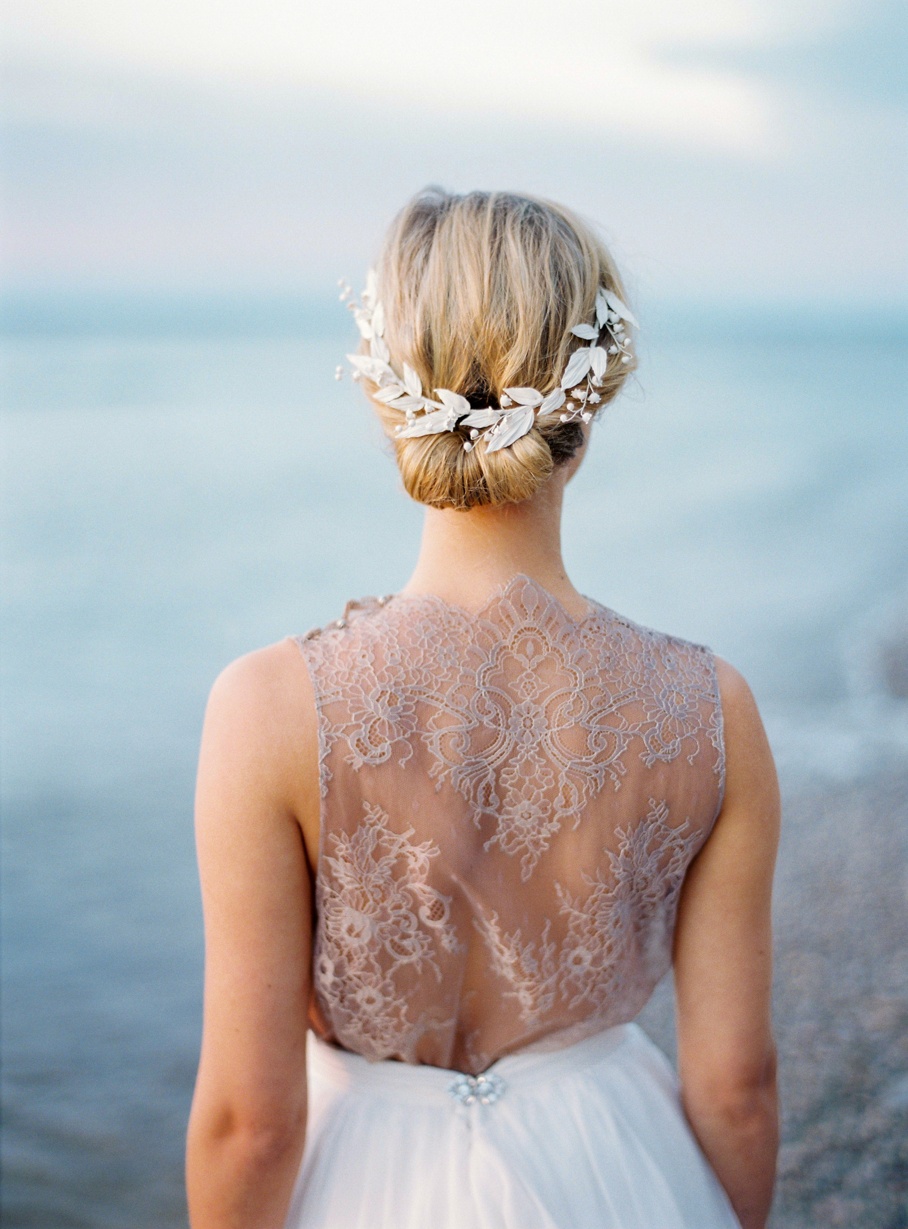 bride with porcelain hair accessory and lace-backed gown