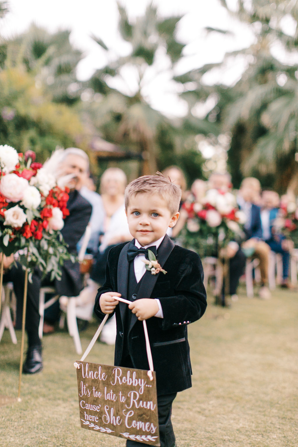 meagan robert wedding ring bearer holding sign