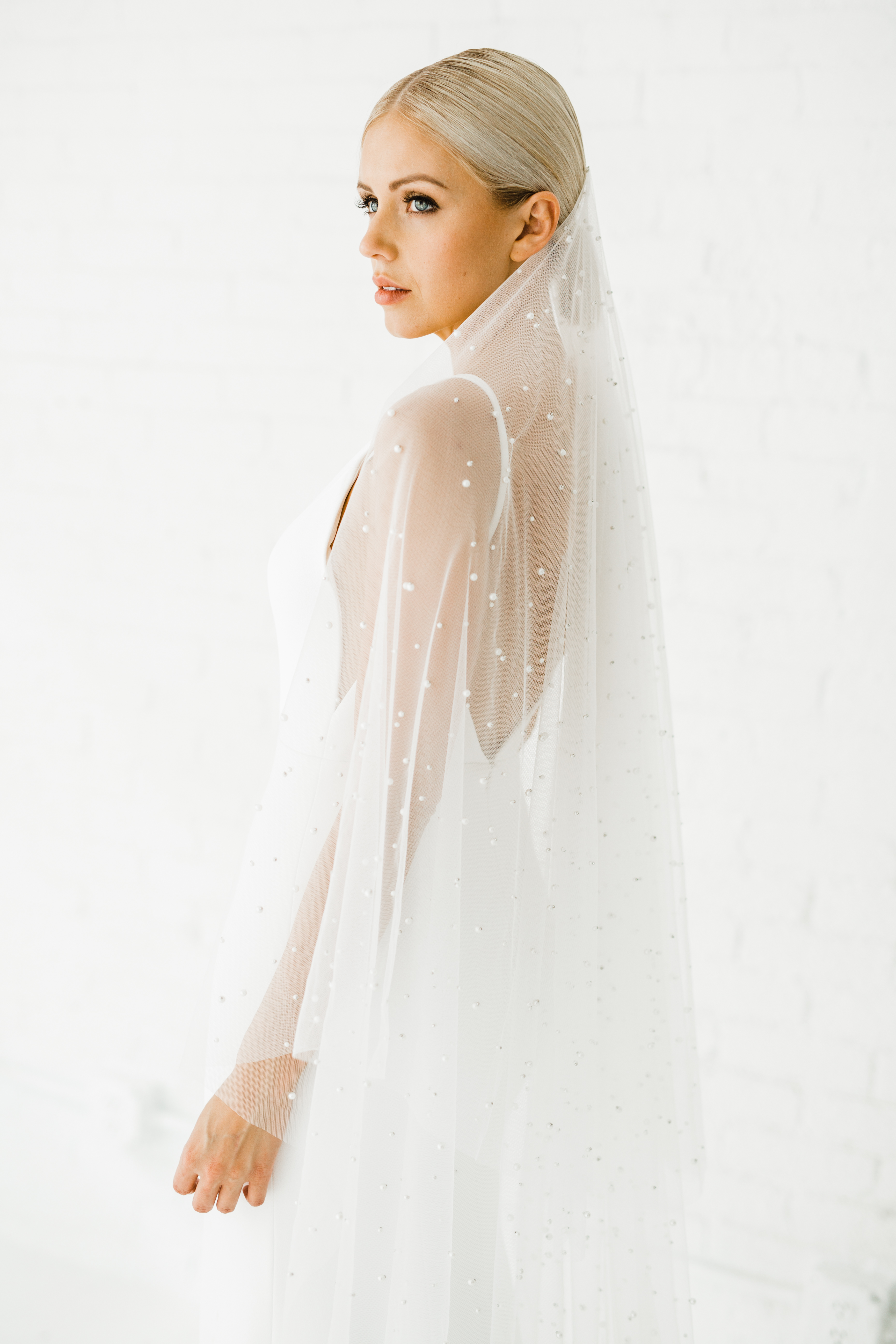 bride wearing pearl-studded veil