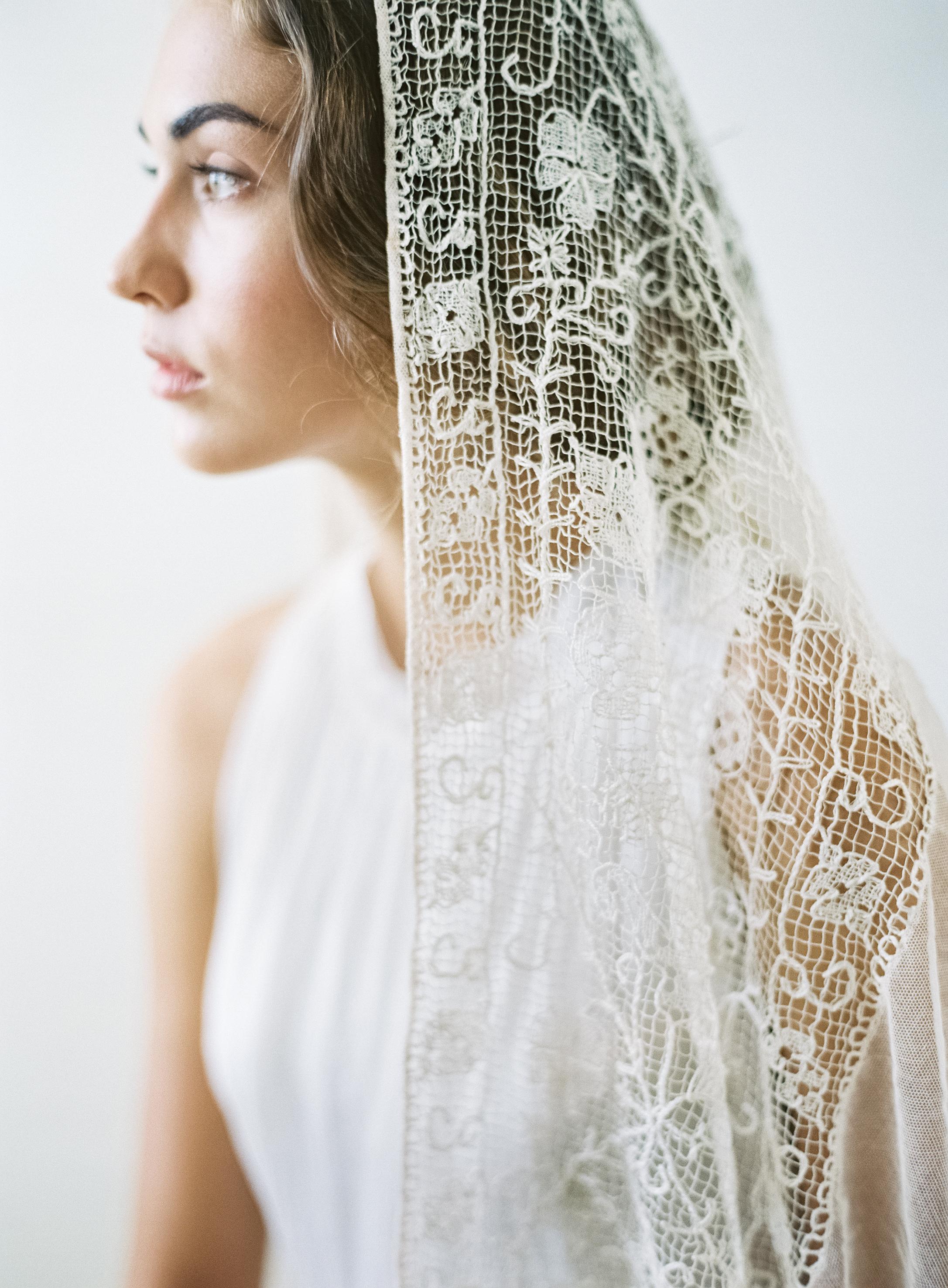 bride wearing crocheted lace veil