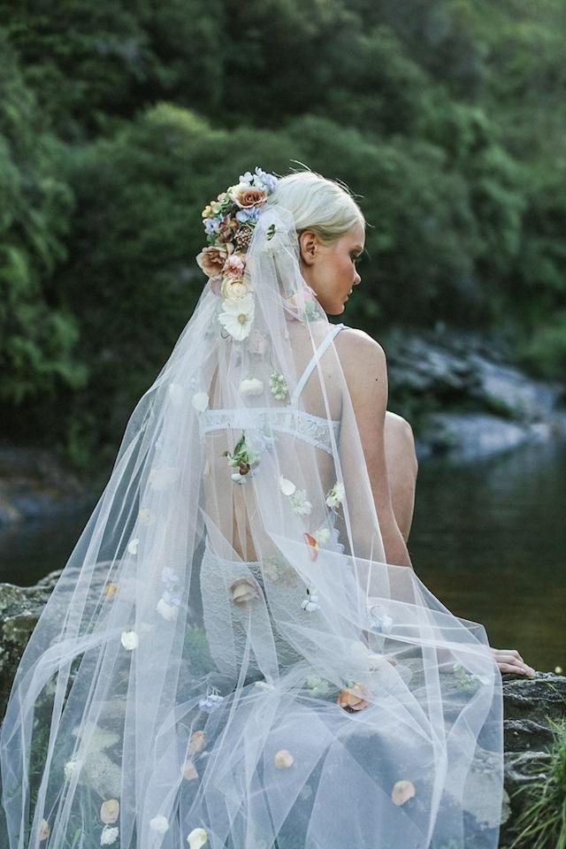 bride wearing veil during boudoir shoot