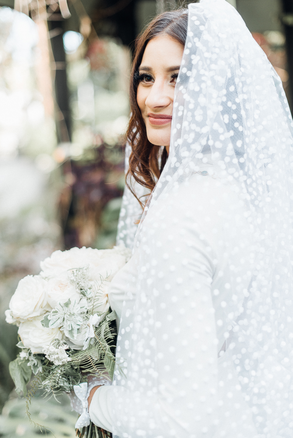 bride wearing polka-dot veil