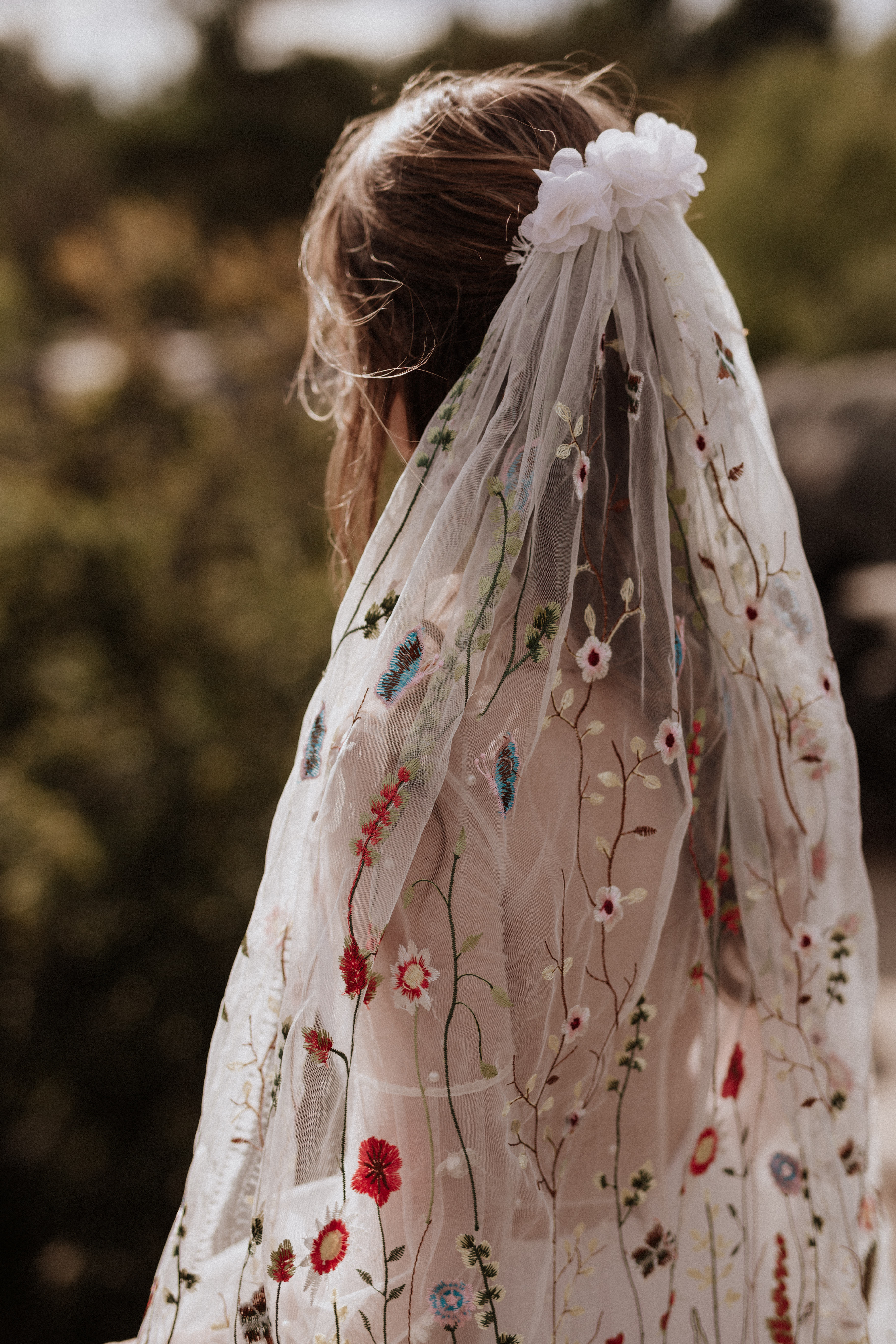 bride wearing embroidered veil