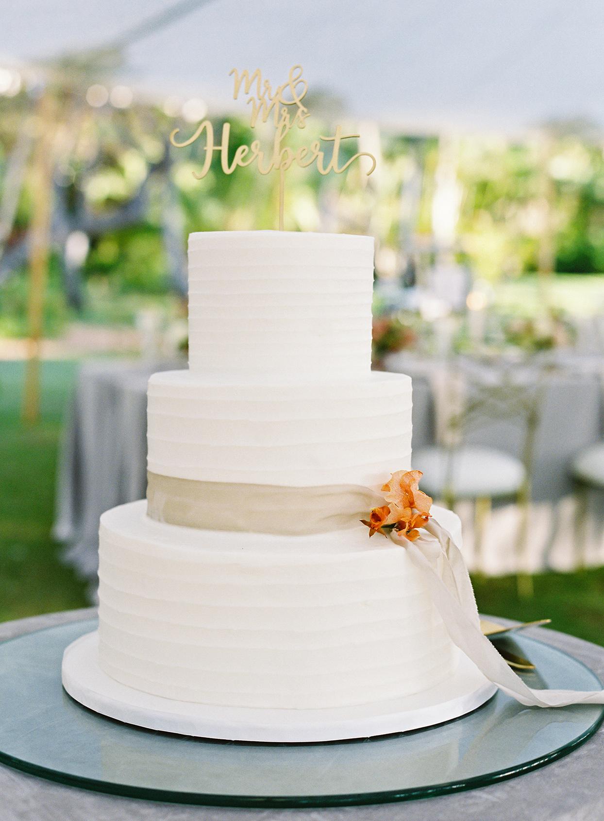 azuki sam wedding white cake with name topper