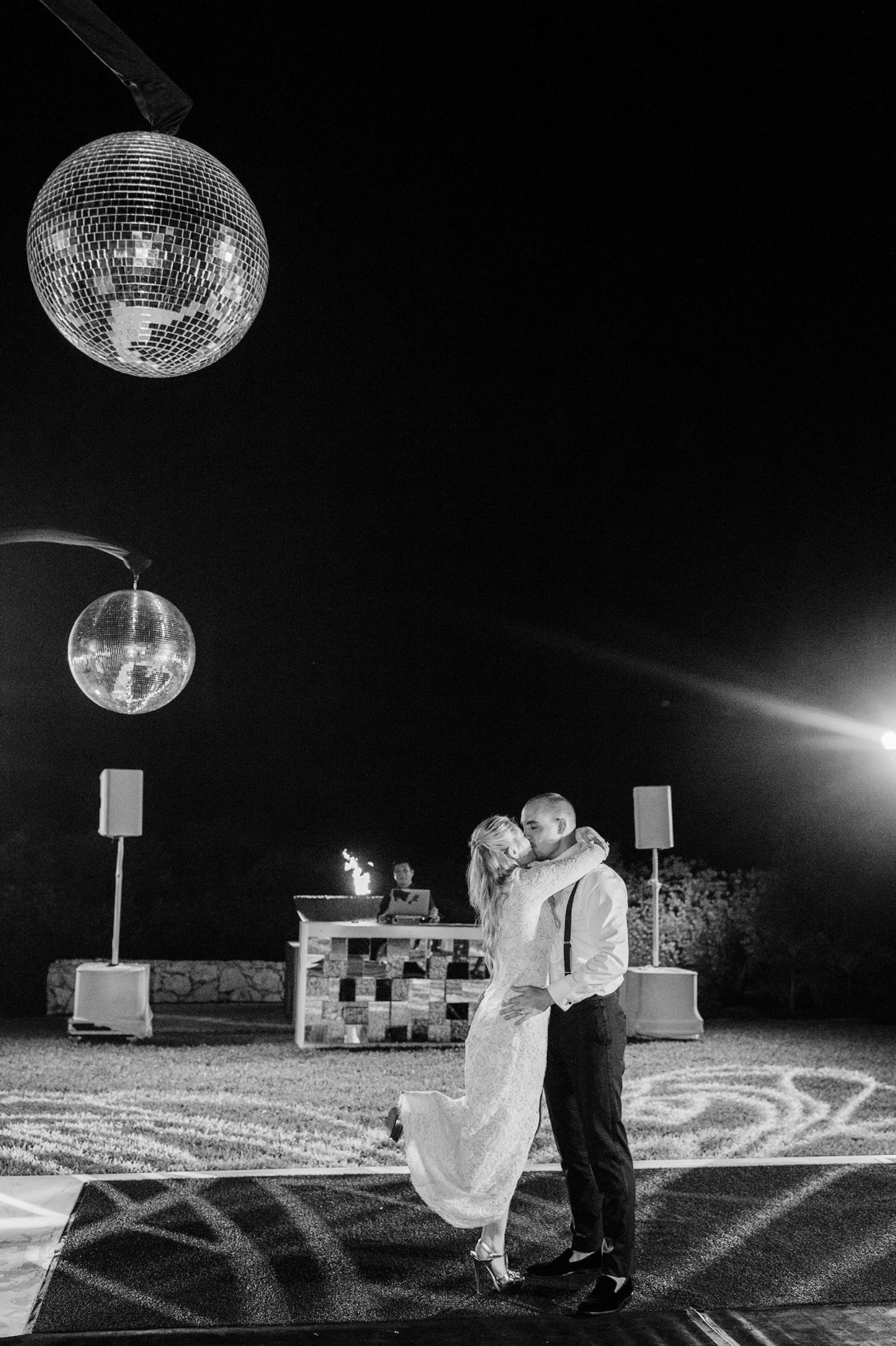 katie nick wedding couple kiss under disco ball