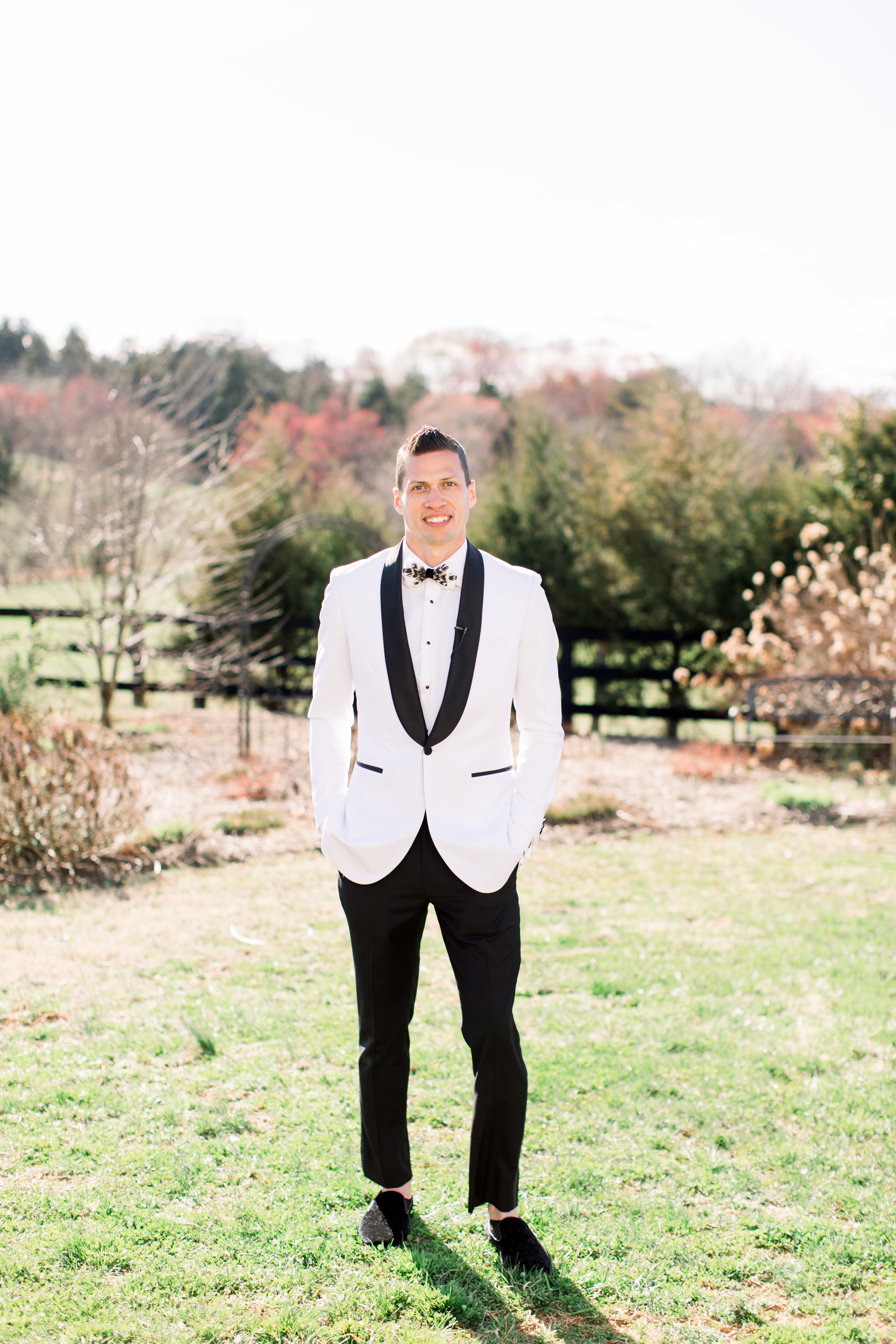 michelle nathan wedding groom in white tuxedo